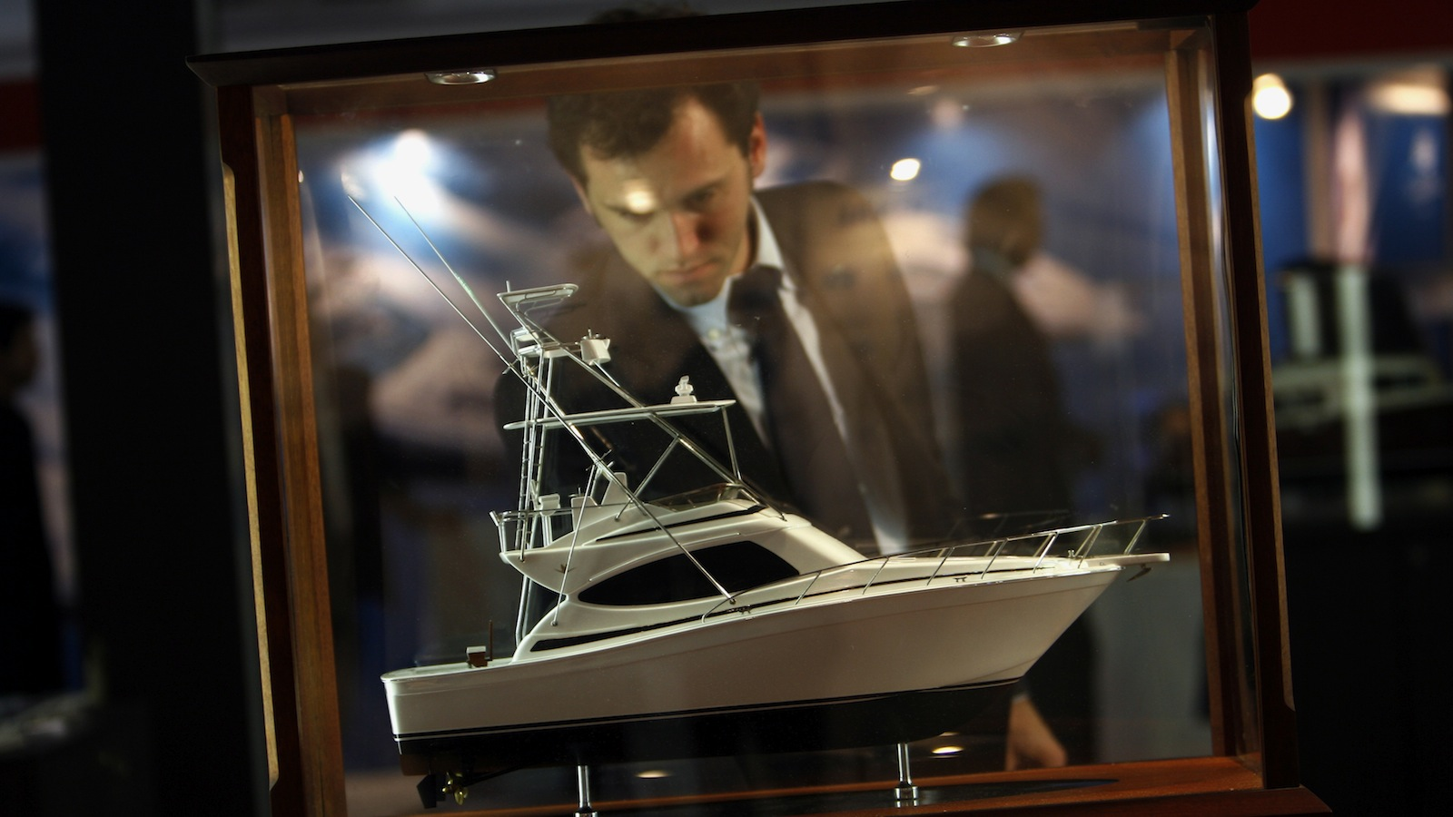 A man stands next to a miniature model of a boat on display at the Samira Mumbai International Boat Show February 28, 2008. The three-day show, which begins on Friday, will showcase international brands from the leisure boating industry. REUTERS/Arko Datta