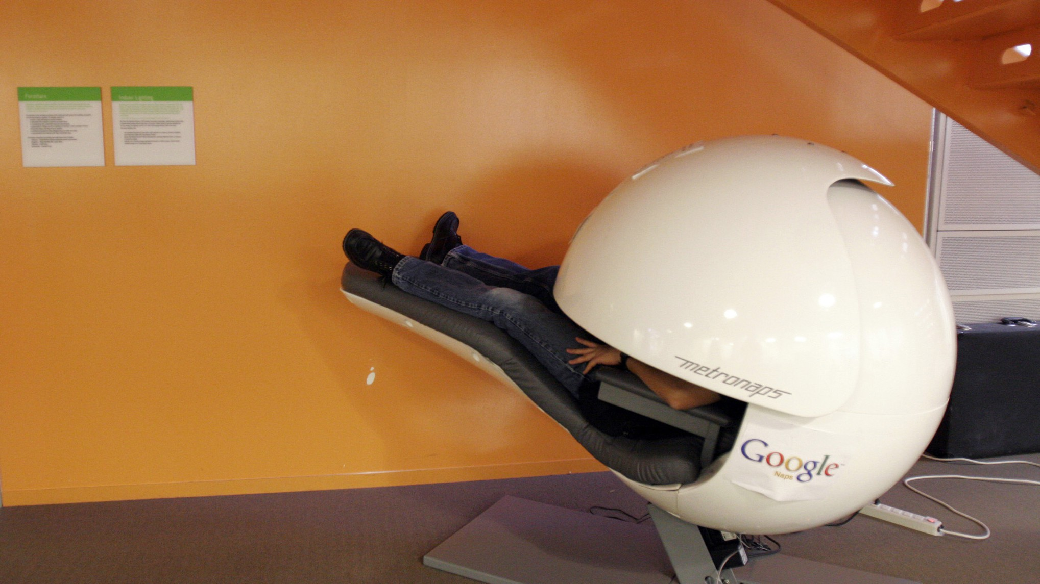 An employee takes a nap in a nap pod which blocks out light and sound at the Google headquarters in Mountain View, California March 3, 2008. REUTERS/Erin Siegal (UNITED STATES) - RTR1XUQ1
