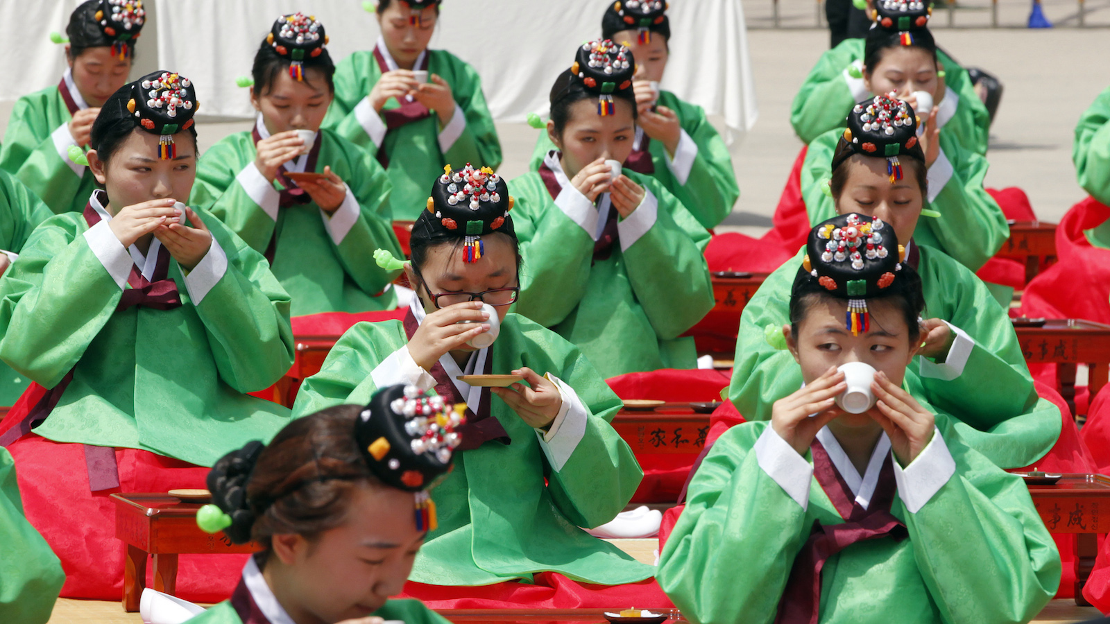 Participants drink tea during a traditional coming-of-age day ceremony in Seoul May 16, 2011. The ceremony marks the entrance of boys and girls into adulthood at the age of 20, and reminds them of their individual responsibilities as young men and women.