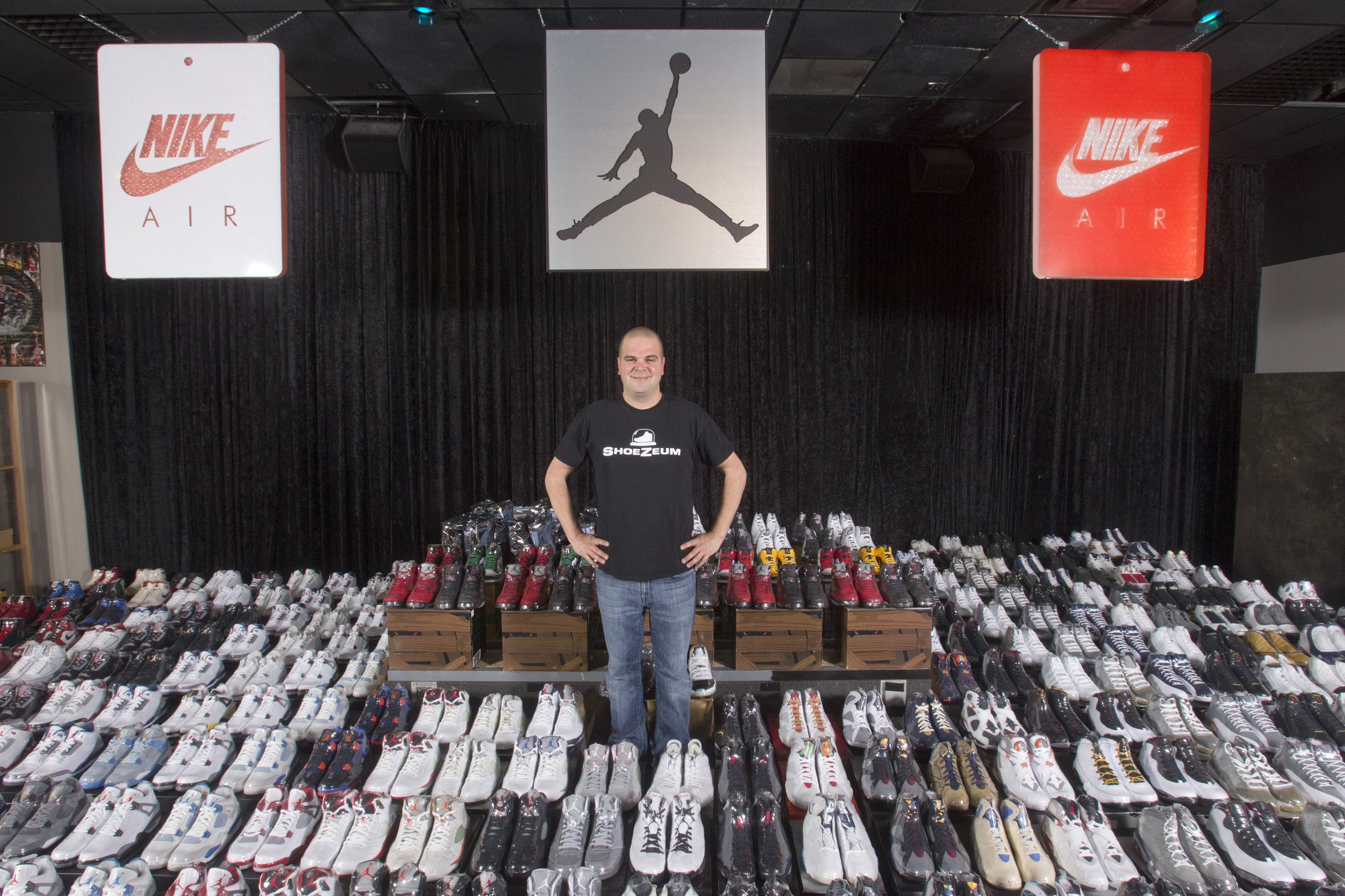 "Jordan Michael Geller poses with his collection of the Nike Air Jordan Retro line at the ""ShoeZeum"" in downtown Las Vegas, Nevada September 25, 2012. Record keepers at the Guinness Book of World Records recently certified that Geller's Shoezeum, a shrine to Nike that he says includes one of every model of Air Jordans ever made, holds the record for the world's largest collection of sneakers, with more than 2,500 pairs, all but eight of which are Nikes. Nike did not respond to calls for comment. Picture taken September 25, 2012. REUTERS/Steve Marcus (UNITED STATES - Tags: SOCIETY) - RTR38IBH"