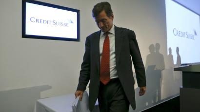 CEO Brady Dougan of Swiss bank Credit Suisse leaves after a news conference to present the bank's results in Zurich.