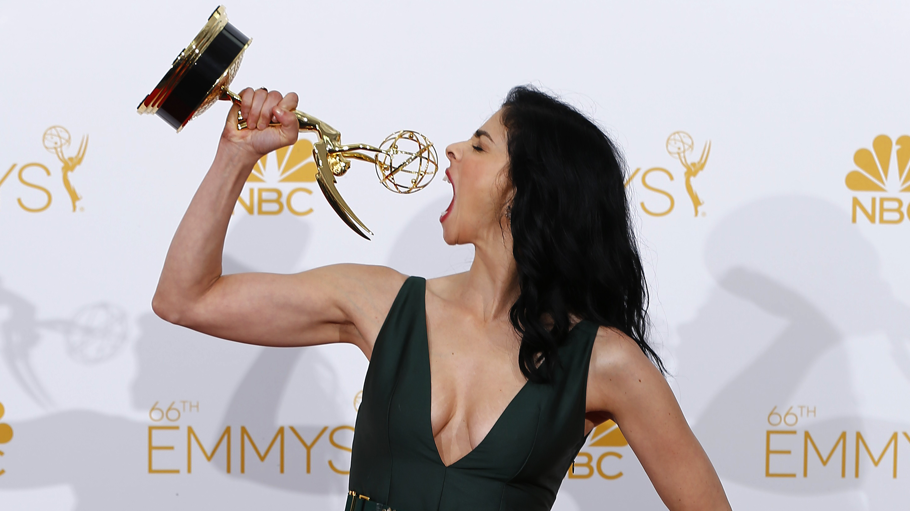 """Sarah Silverman poses with her Outstanding Writing for a Variety Special award for HBO's """"Sarah Silverman: We Are Miracles"""" at the 66th Primetime Emmy Awards in Los Angeles, California August 25, 2014."""