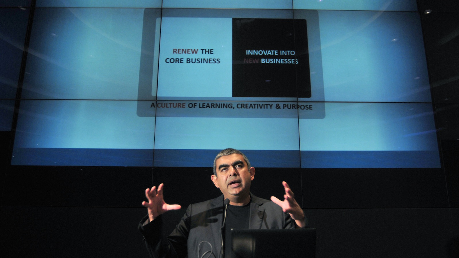Infosys Chief Executive Officer Vishal Sikka speaks during the announcement of the company's quarterly financial results at the company's headquarters in the southern Indian city of Bangalore October 10, 2014. Infosys Ltd wants to revive growth through automation and artificial intelligence, Sikka said on Friday, boosting investors' confidence in India's second largest IT exporter after it posted a forecast-beating quarterly profit. REUTERS/Abhishek N. Chinnappa