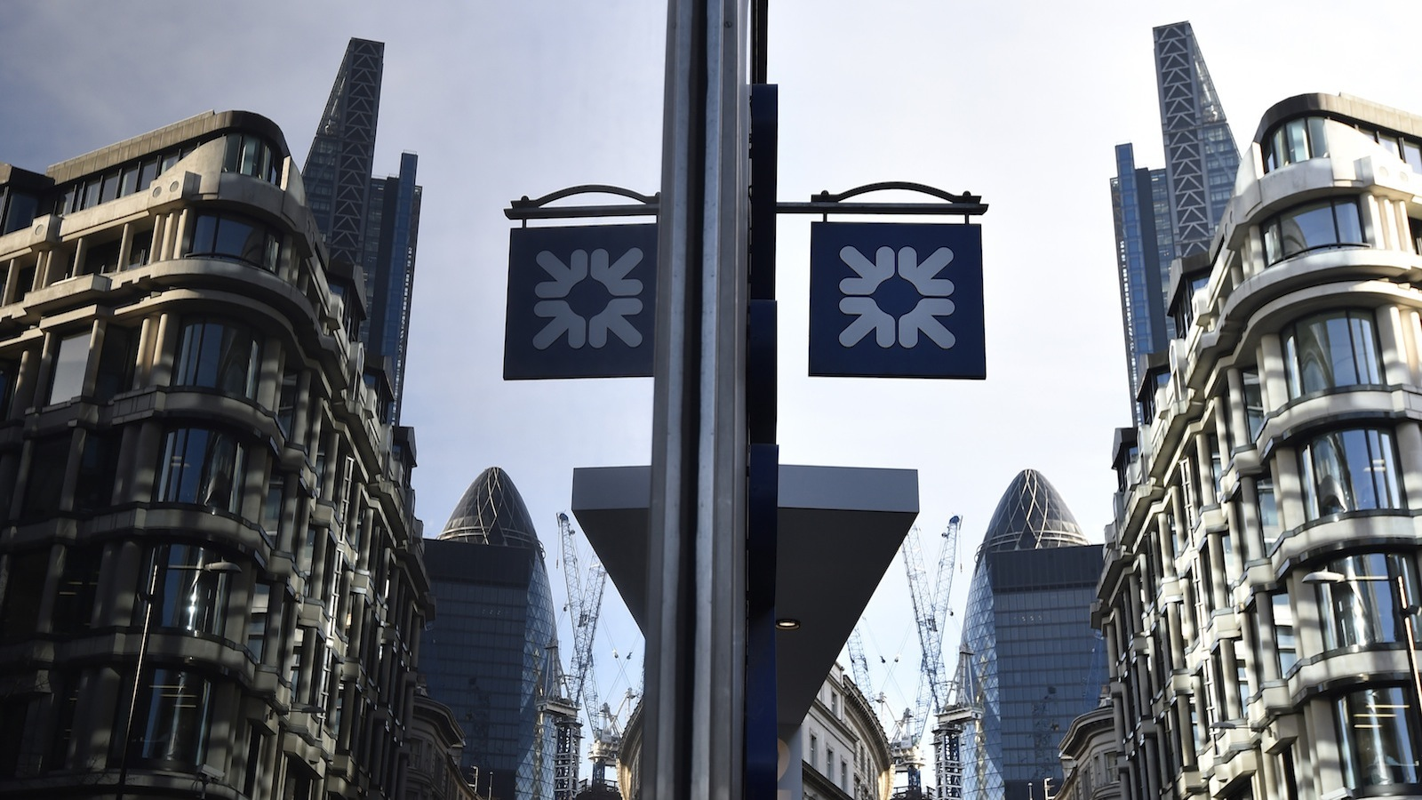 A branch of the Royal Bank of Scotland is seen in the City of London December 16, 2014. The Bank of England warned Britain's banks they should expect a more exacting test next year of their defences in the event of a crisis abroad, after state-backed lenders narrowly passed a debut check focused on potential domestic strains. Lloyds and rival Royal Bank of Scotland scraped through this year's test, proving they could withstand the regulator's doomsday scenario of plummeting UK house prices and soaring unemployment, after both took pre-emptive measures to shrink their balance sheets and raise capital. REUTERS/Toby Melville
