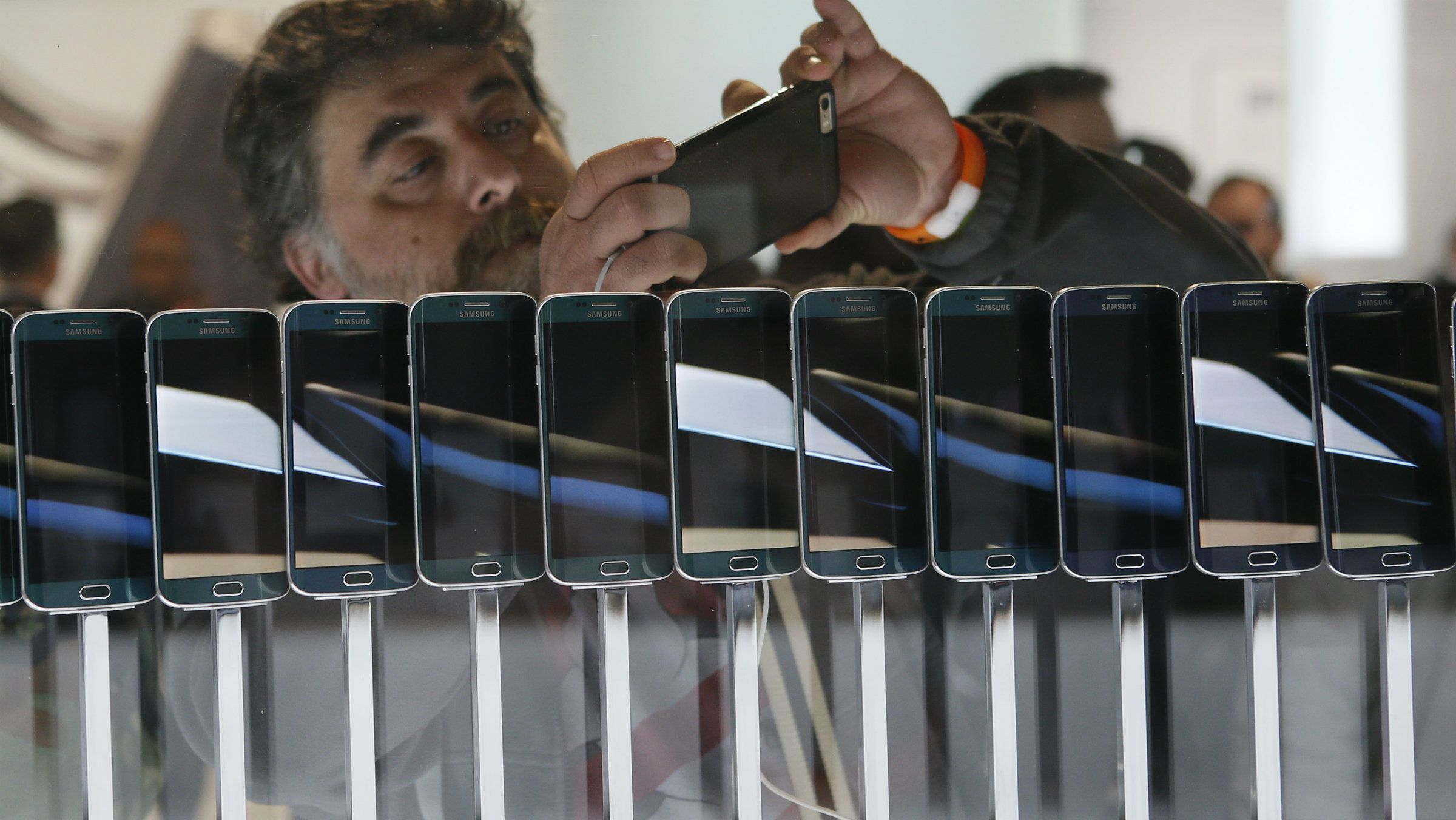 A row of smartphones are seen on display at the Mobile World Congress in Barcelona March 1, 2015.