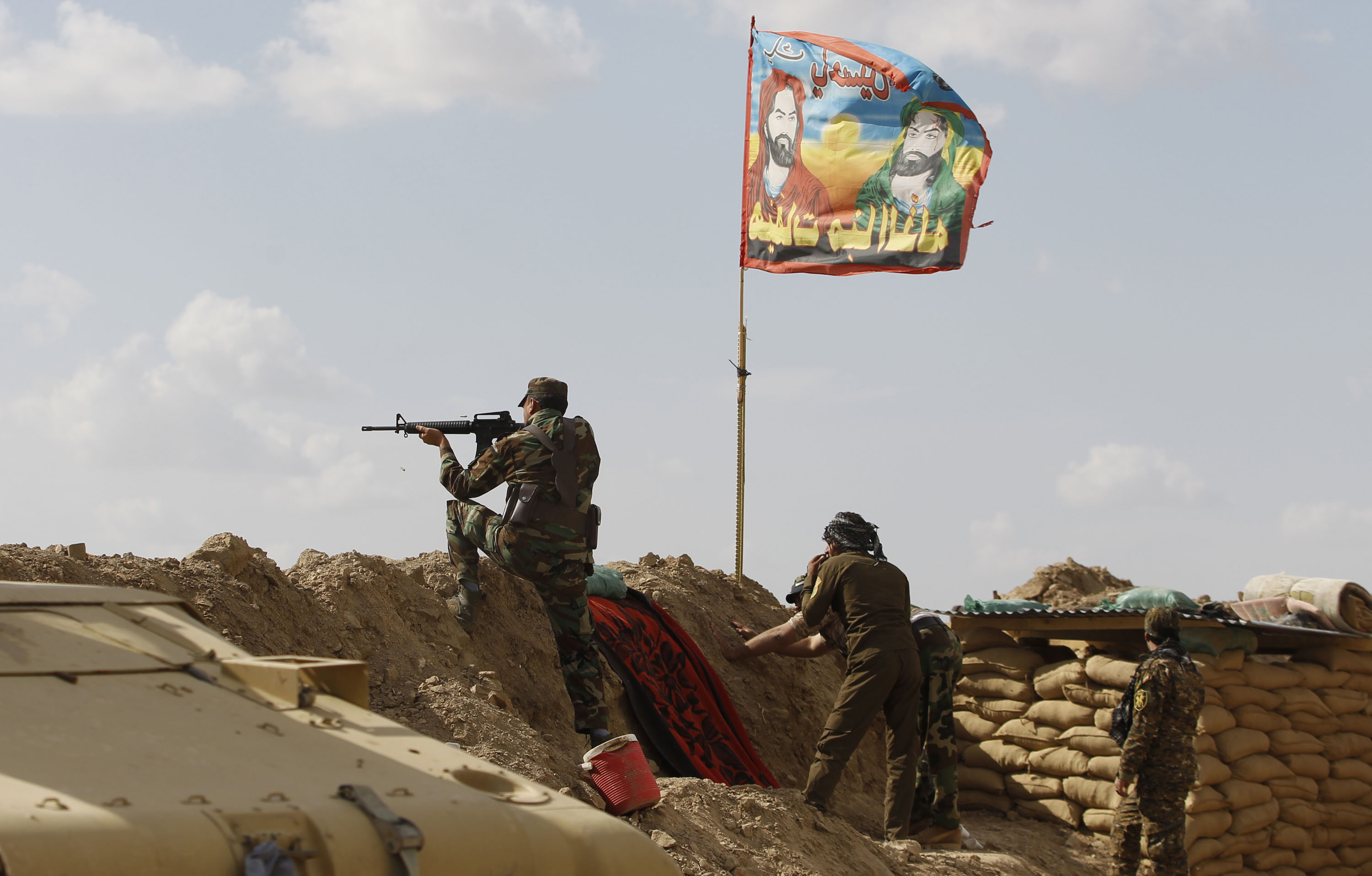 DATE IMPORTED: March 02, 2015 Shi'ite fighters clash with Islamic State militants at Udhaim dam, north of Baghdad, March 2, 2015. Iraq's armed forces, backed by Shi'ite militia, attacked Islamic State strongholds north of Baghdad on Monday as they launched an offensive to retake the city of Tikrit and the surrounding Sunni Muslim province of Salahuddin. REUTERS/Thaier Al-Sudani