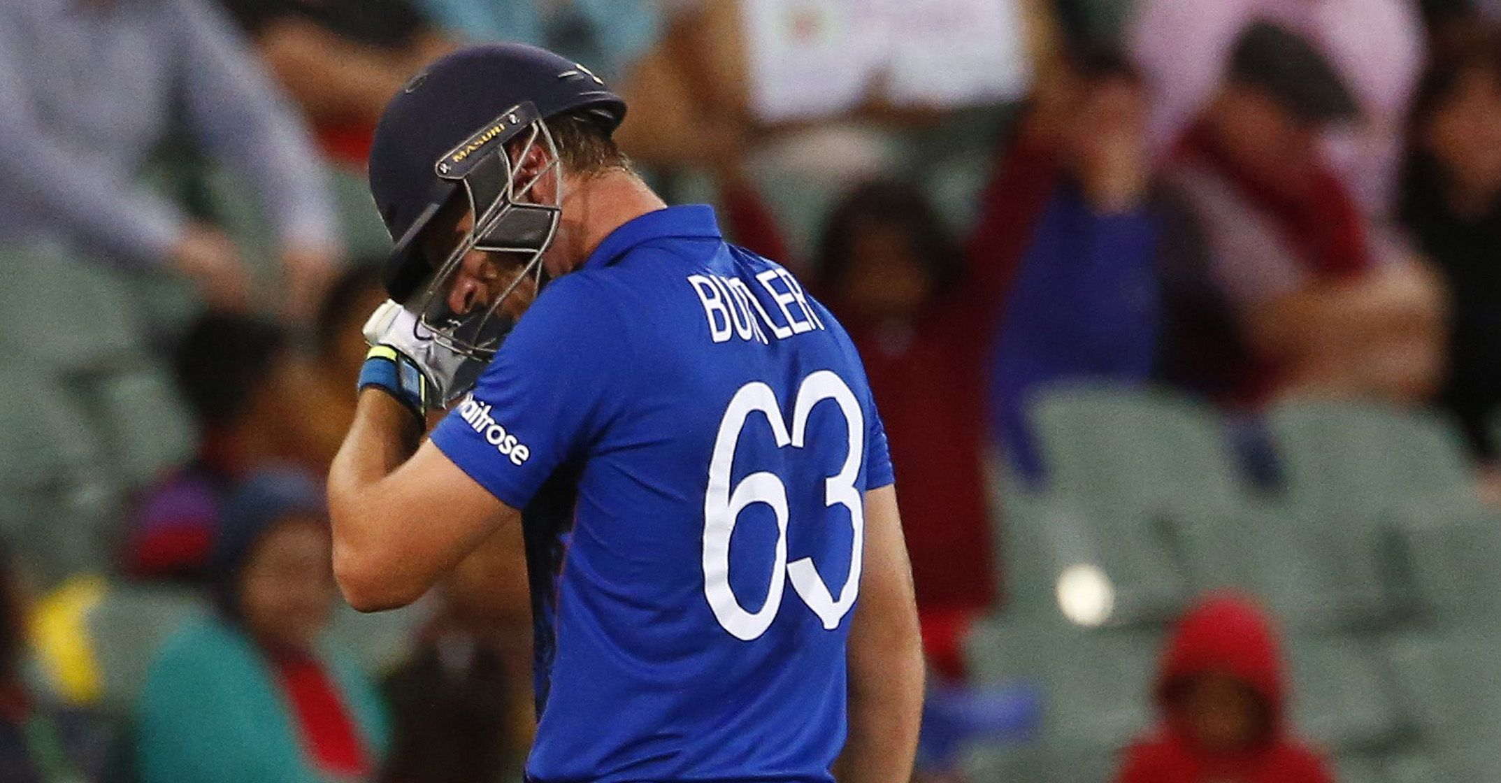 England batsman Jos Buttler walks off the field after getting caught behind by Bangladesh's wicketkeeper Mushfiqur Rahim during their Cricket World Cup match in Adelaide, March 9, 2015.     REUTERS/David Gray   (AUSTRALIA - Tags: SPORT CRICKET) - RTR4SLEB