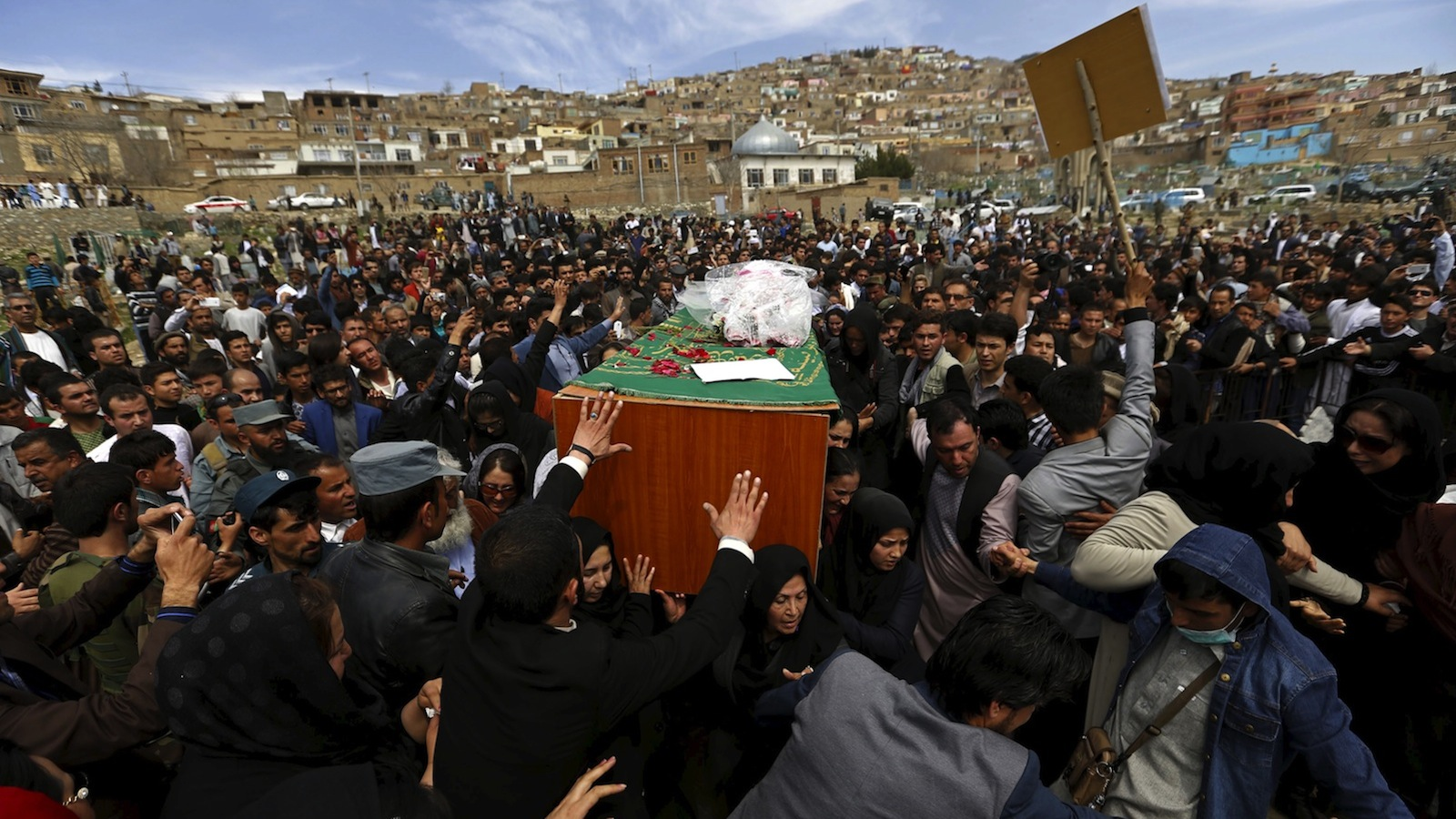 Afghan women's rights activists carry the coffin of Farkhunda, an Afghan woman who was beaten to death and set alight on fire on Thursday, during her burial ceremony in Kabul March 22, 2015. REUTERS/Mohammad Ismail