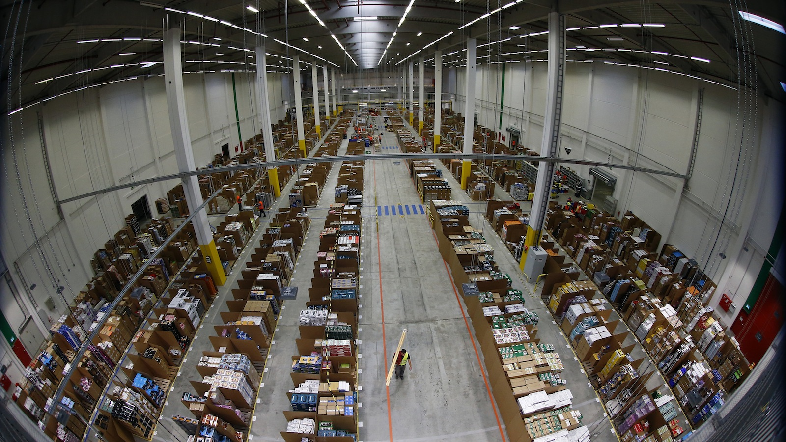 "A general view of the storage hall at the 70,000 square metre warehouse floor in Amazon's new distribution center in Brieselang, near Berlin November 28, 2013. Germany's antitrust watchdog has dropped an investigation into Amazon after the world's biggest Internet retailer agreed to stop forcing third-party merchants to offer their cheapest price when selling products on its platform. Andreas Mundt, the president of the German cartel office, said it had decided to set aside the case against Amazon after the company agreed to cancel that demand from the terms and conditions of its contracts with merchants. ""Making pricing demands to your own competitors cannot be justified in any circumstances, not even with the undeniable advantages of an online market place."" REUTERS/Tobias Schwarz"