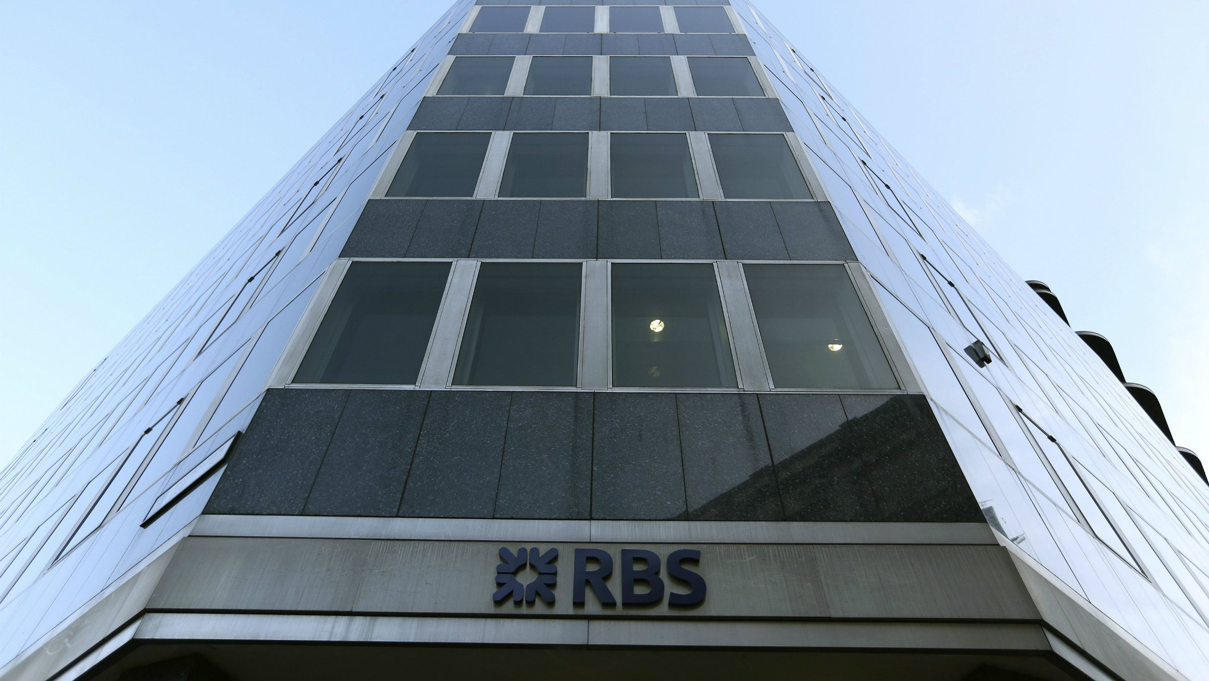 A sign is seen outside a Royal Bank of Scotland building in central London.