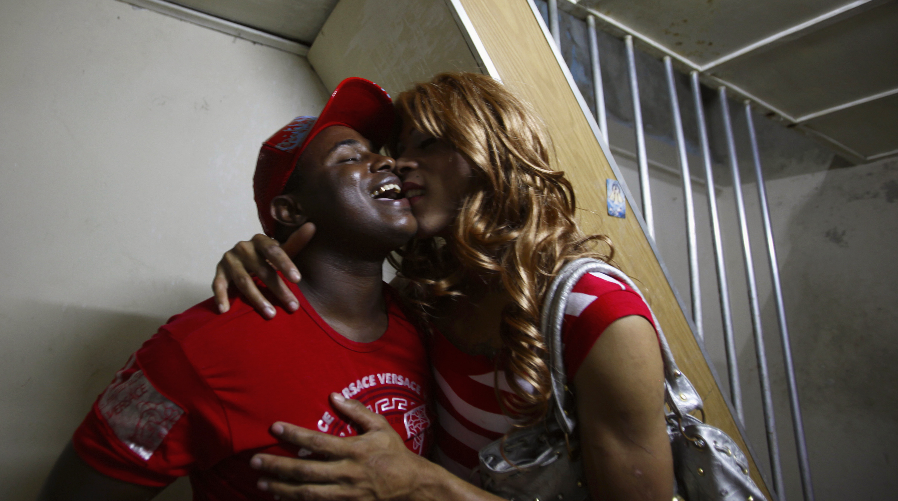 Transvestite Julio Yoaris Alvarez and his boyfriend El Moro kiss at their home as the world celebrates International Day Against Homophobia in Havana May 16, 2009. From an early age, Alvarez dreamt of having a sex-change operation and is currently awaiting his turn for one under the Cuban health care system. The surgery, like all other health care in Cuba, will be free of charge for applicants.