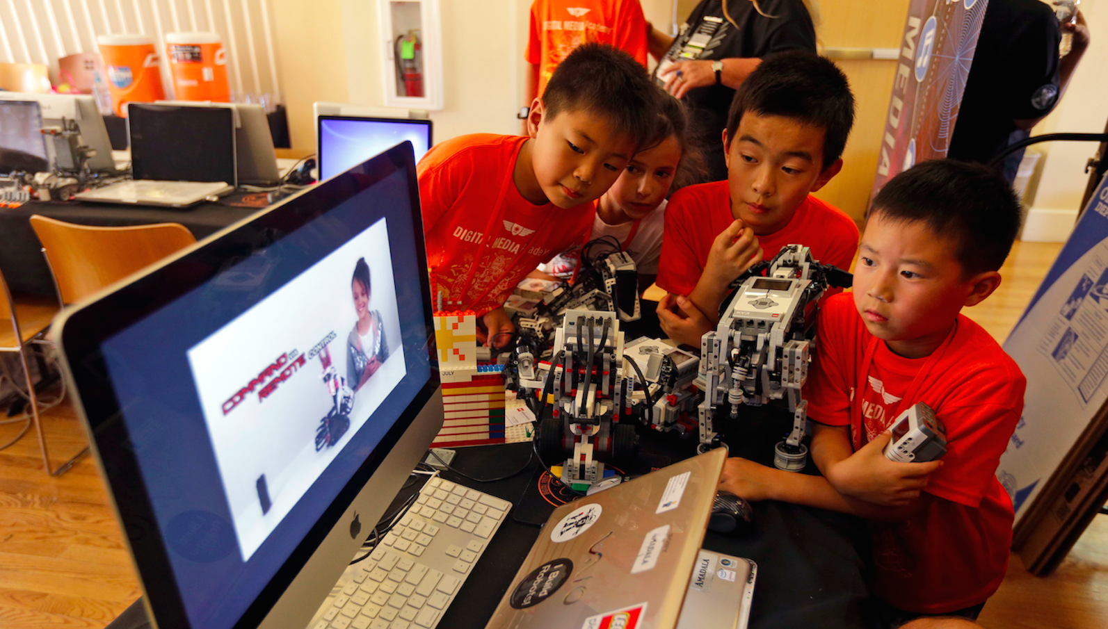 In this Aug. 14, 2013 file photo, children look at a computer presentation on how to assemble Lego parts during a Digital Media Academy workshop in Stanford, Calif.