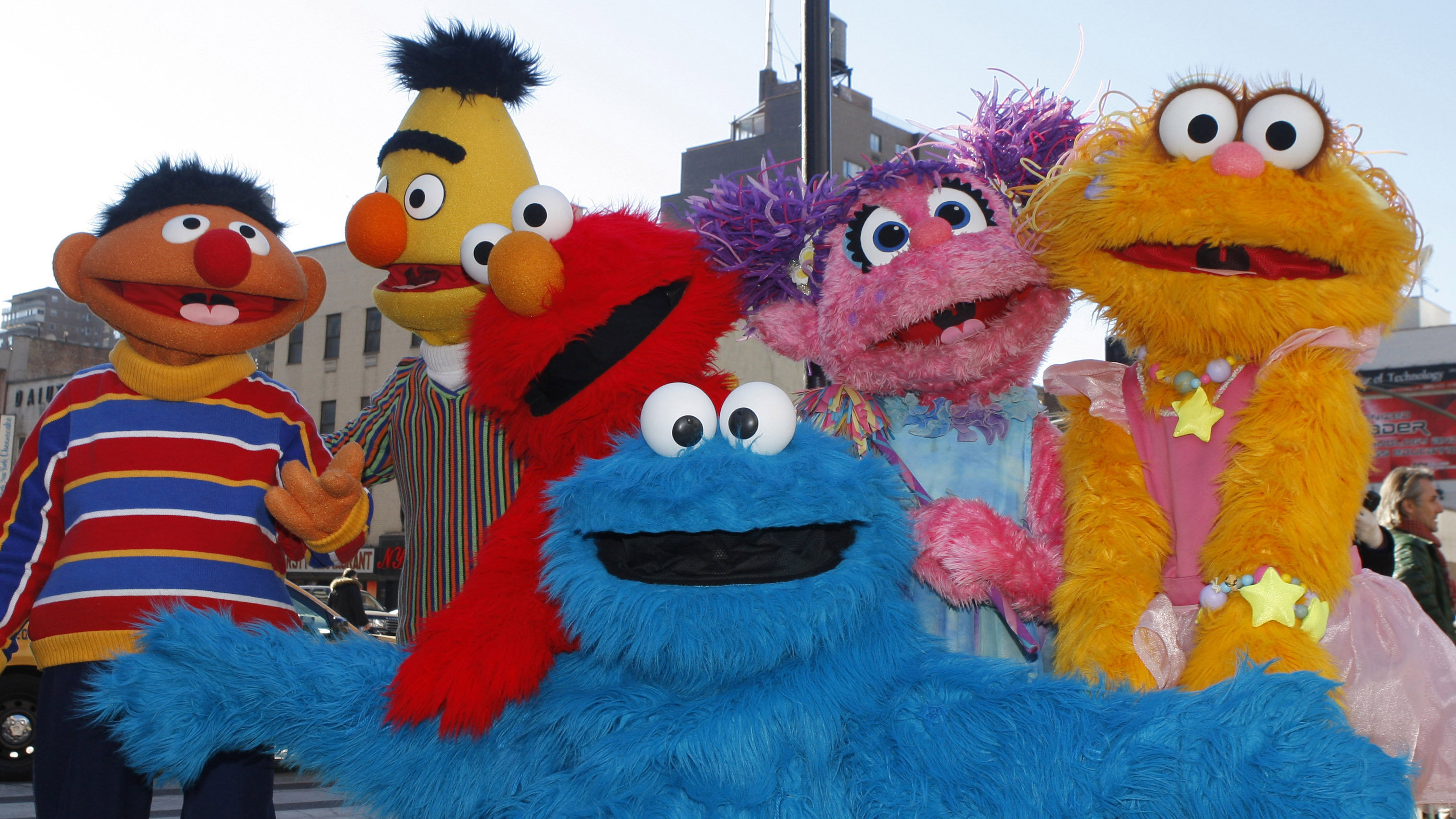 Characters from Sesame Street Live appear on the street by Madison Square Garden to celebrate the 30th anniversary of the live touring stage shows based on the PBS television series in New York, Thursday, Feb. 4, 2010. From left are Ernie, Bert, Elmo, Cookie Monster (foreground), Abby Cadabby, and Zoe.