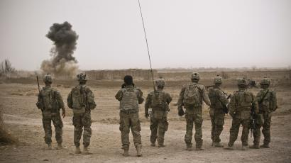 soldiers watching explosion