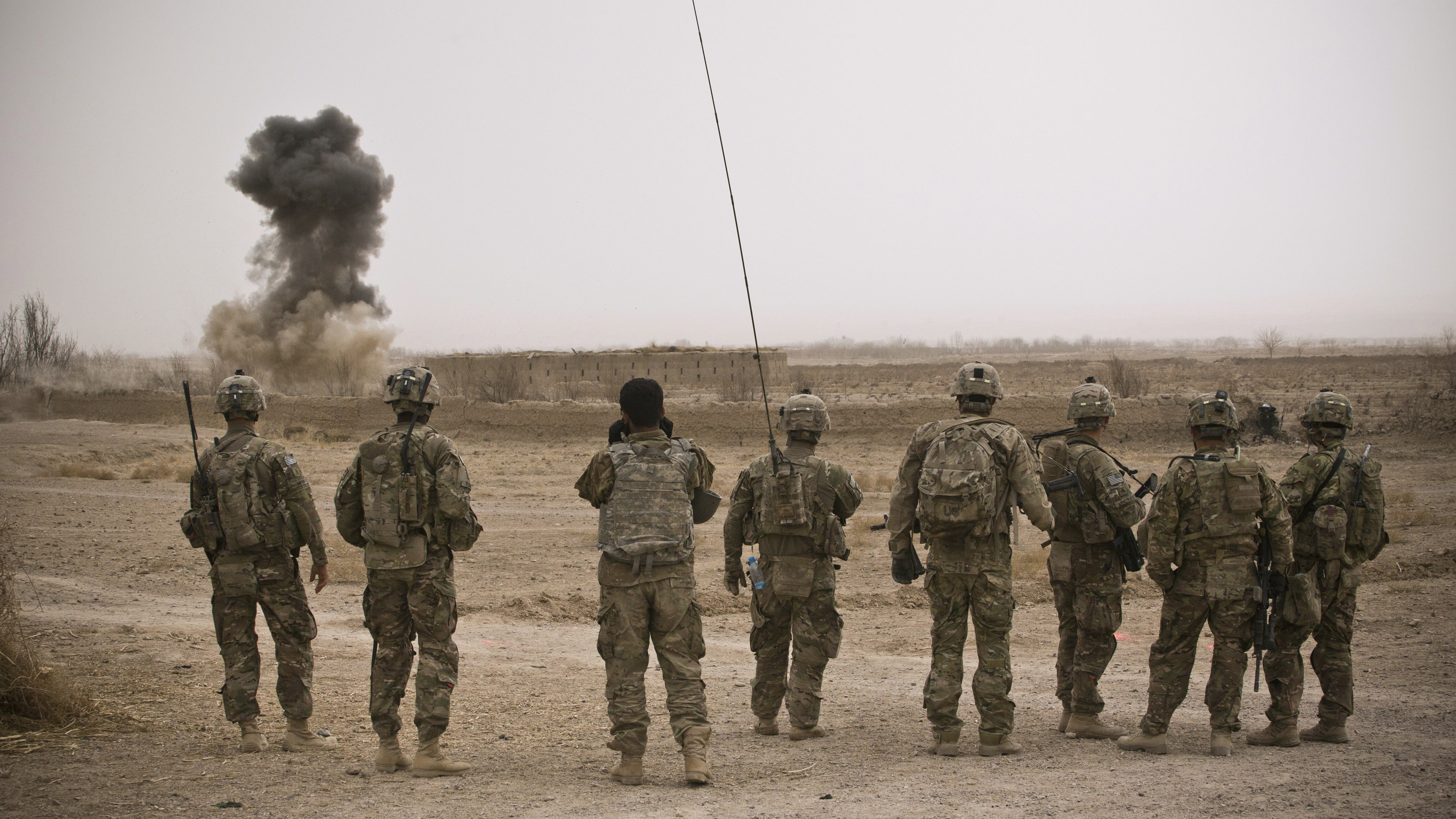 U.S. Army soldiers watch a controlled detonation during a mission near Command Outpost AJK (short for Azim-Jan-Kariz, a near-by village) in Maiwand District, Kandahar Province January 30, 2013.