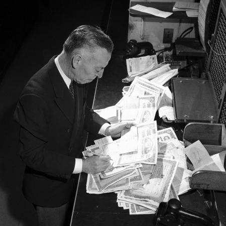 New York Club Exchange Securities A.A. Callaghan, teller in the Clearing Corporation is preparing stock certificates for final delivery in New York, Sept. 6, 1947.