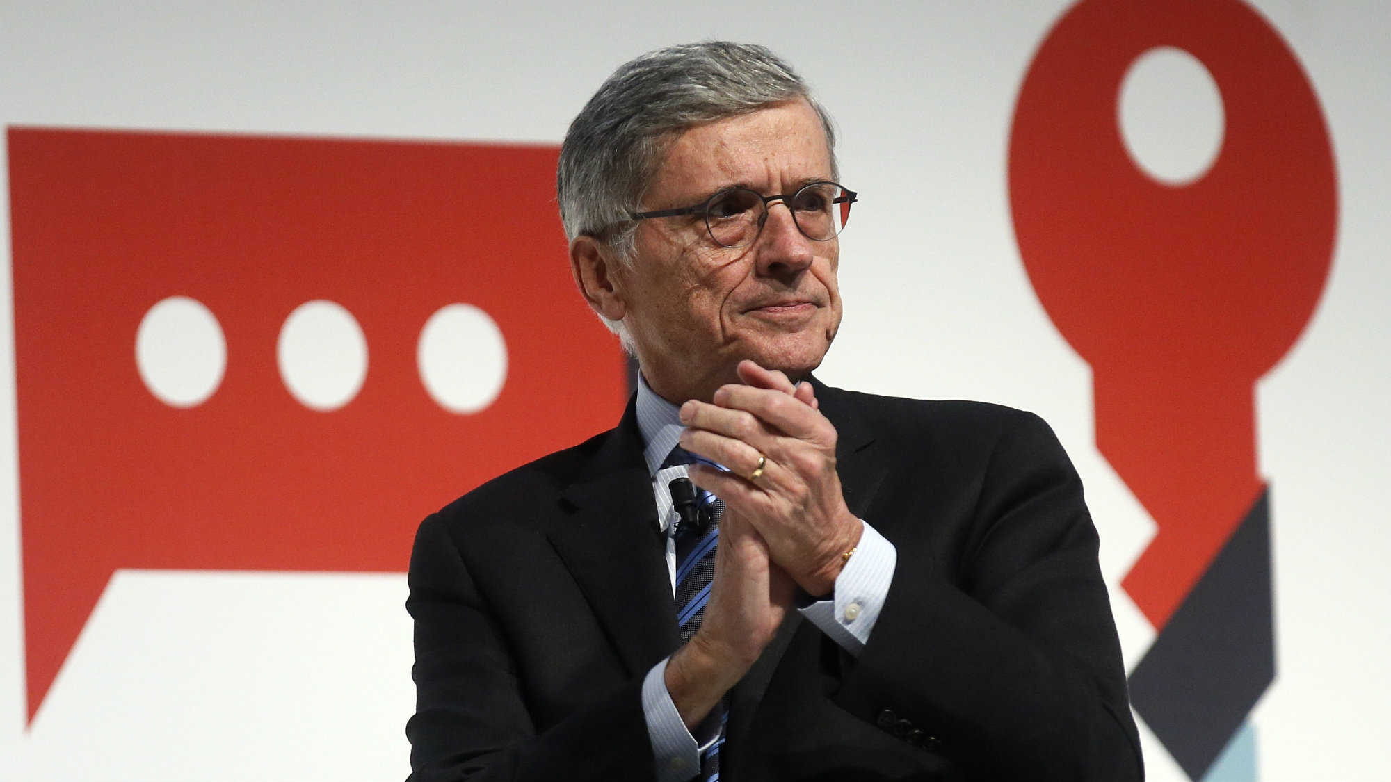 Tom Wheeler, the head of the U.S. Federal Communications Commission, gestures as he delivers a keynote speech during the Mobile World Congress in Barcelona March 3, 2015. Ninety thousand executives, marketers and reporters gather in Barcelona this week for the telecom operators Mobile World Congress, the largest annual trade show for the global wireless industry. REUTERS/Albert Gea (SPAIN - Tags: BUSINESS SCIENCE TECHNOLOGY BUSINESS TELECOMS)