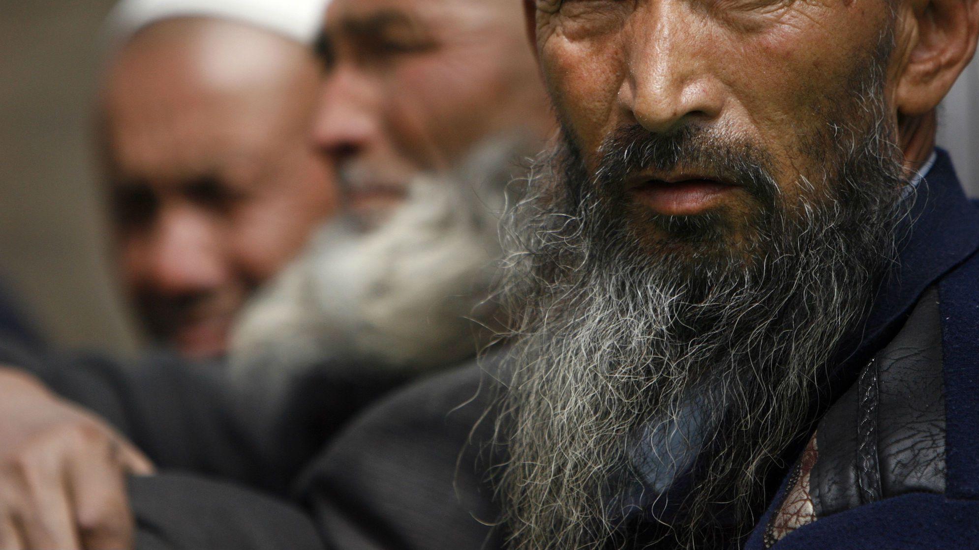 Uighur men in Yarkand Xinjiang