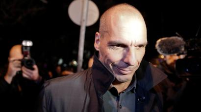 Greece's newly appointed Finance Minister Yanis Varoufakis leaves the presidential palace.