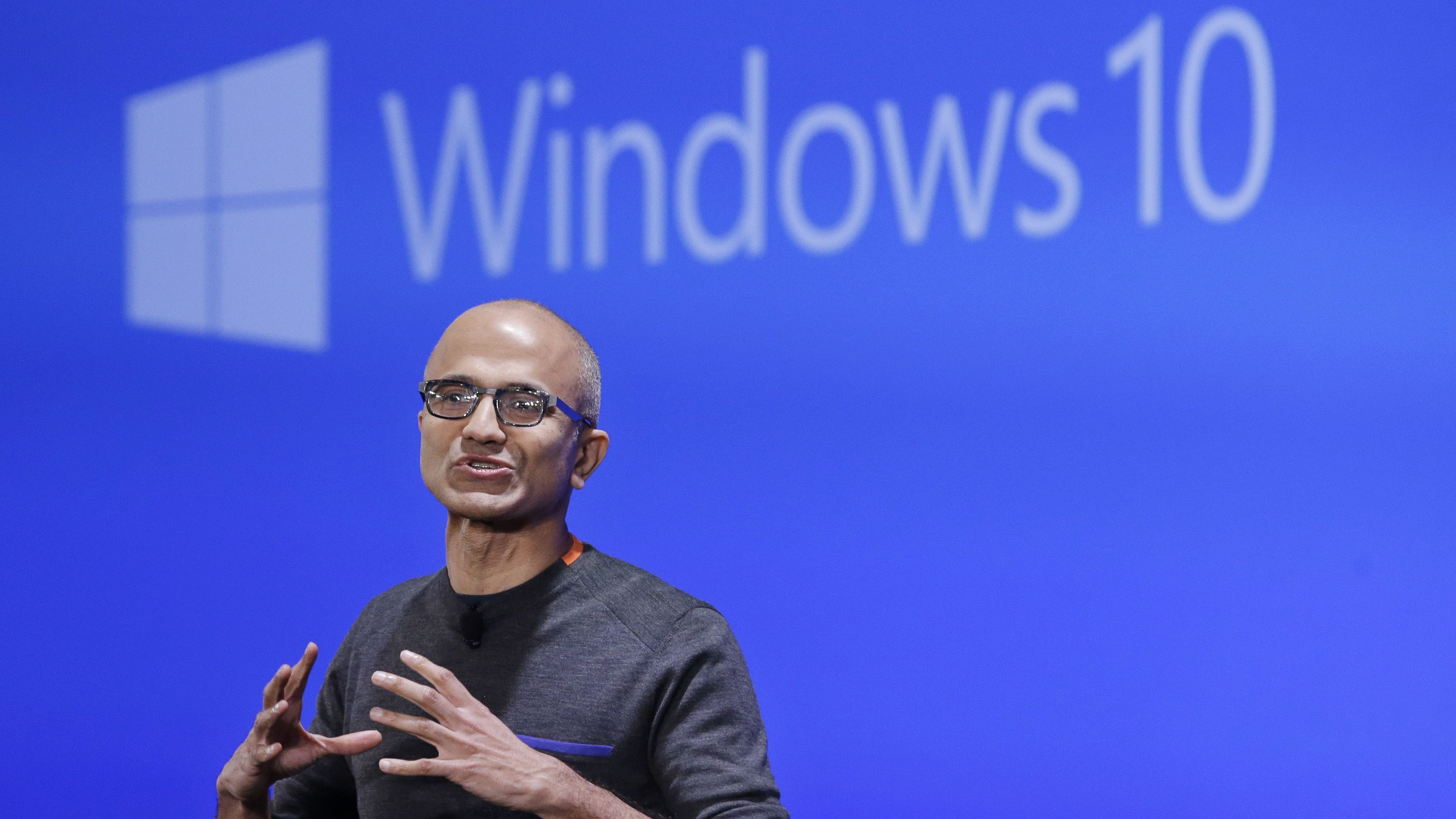 FILE - In this Jan. 21, 2015 file photo, Microsoft CEO Satya Nadella speaks at an event demonstrating the new features of Windows 10 at the company's headquarters in Redmond, Wash. Microsoft reports quarterly financial results on Monday, Jan. 26, 2015. (AP Photo/Elaine Thompson, File)