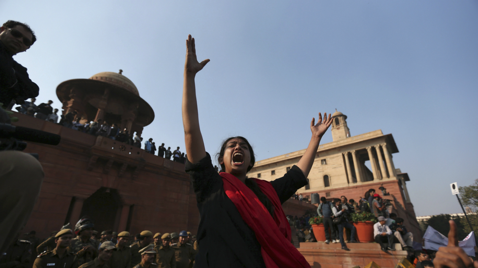 A demonstrator shouts slogans during a protest rally near the presidential palace in New Delhi December 22, 2012. Indian police used batons, tear gas and water cannon to turn back thousands of people marching on the presidential palace on Saturday in intensifying protests against the gang-rape of a woman on the streets and on social media. REUTERS/Ahmad Masood (INDIA - Tags: CRIME LAW CIVIL UNREST)