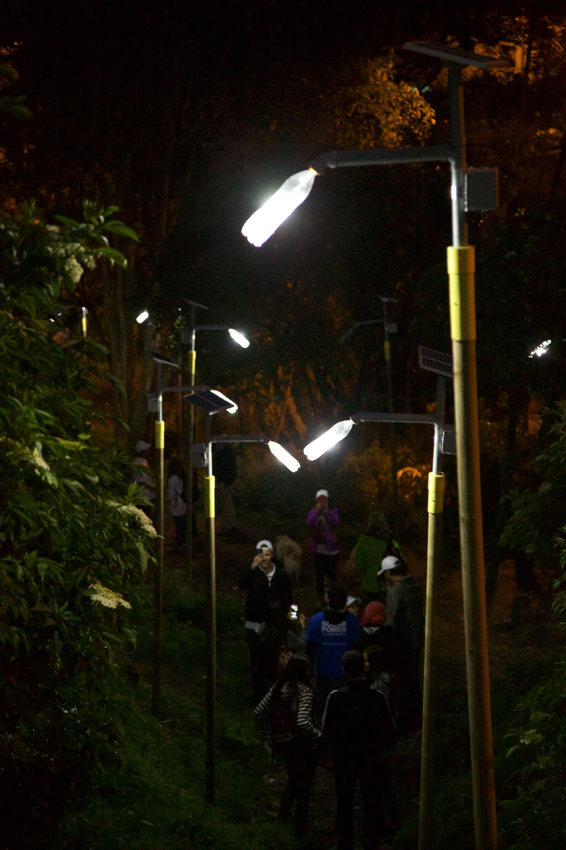 Liter of Light streetlamps lit up at night in San Luis, Bogota