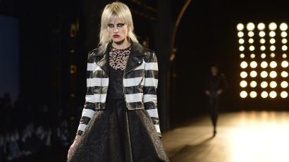 32b51c2cbdc A model presents a creation for Saint-Laurent during the 2015-2016 fall/