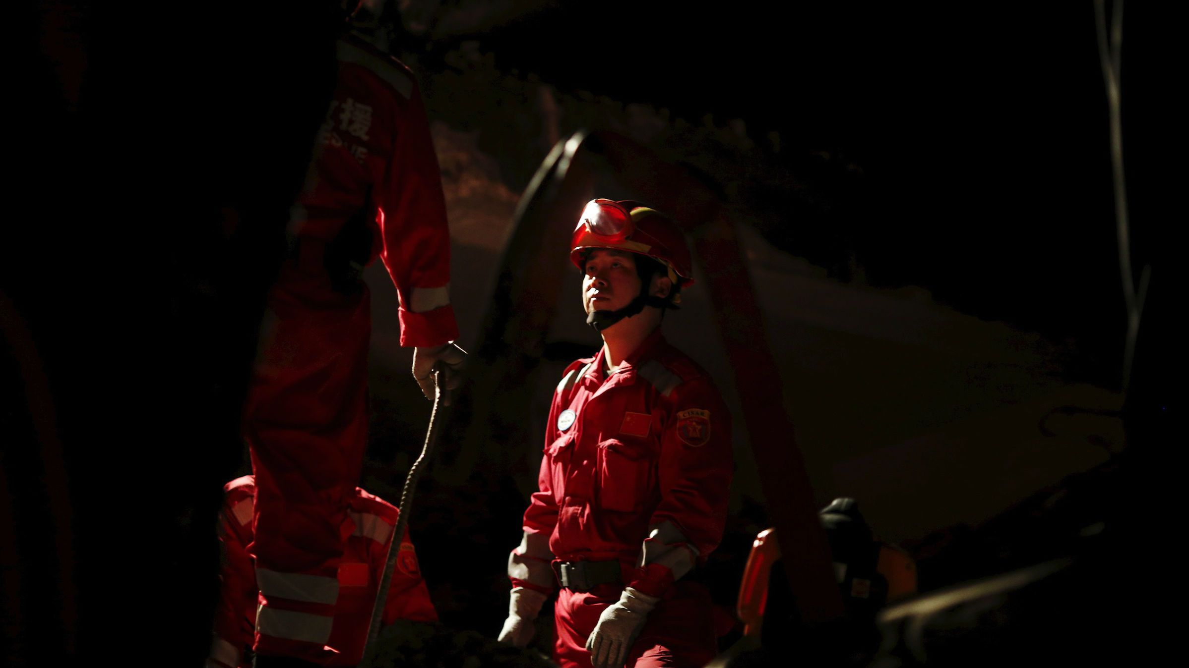 A Chinese rescue worker in a collapsed hotel in Kathmandu