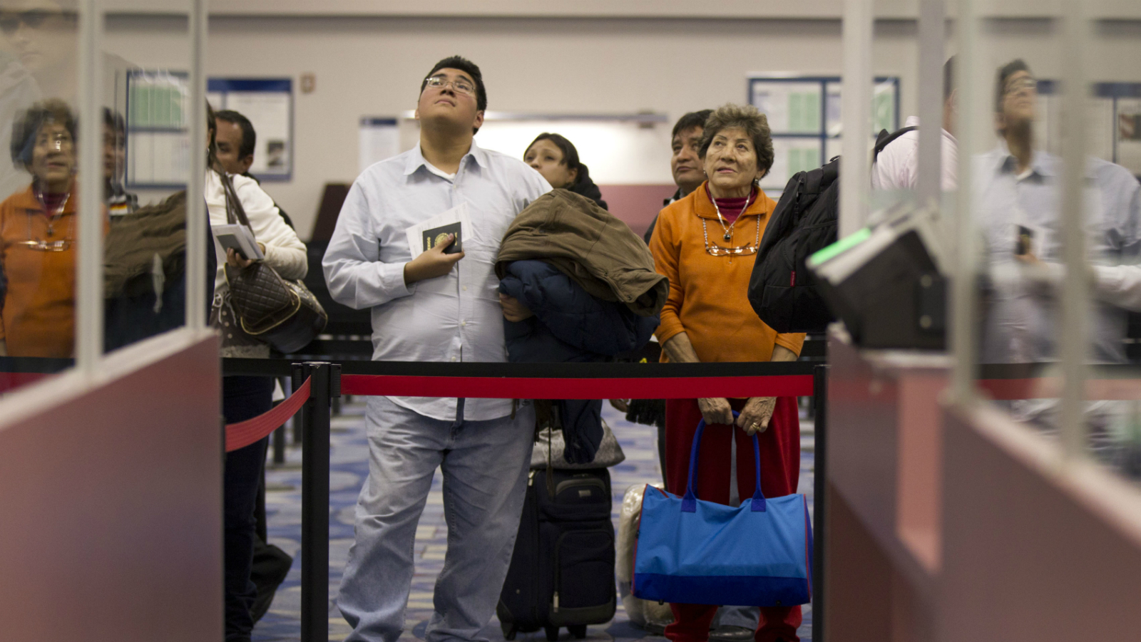 Non-resident visitors to the United States wait in line at immigration control after arriving at McCarran International Airport, Tuesday, Dec. 13, 2011, in Las Vegas. The U.S. Travel Association is pushing Congress to make it easier for foreigners to visit the United States. (AP Photo/Julie Jacobson)