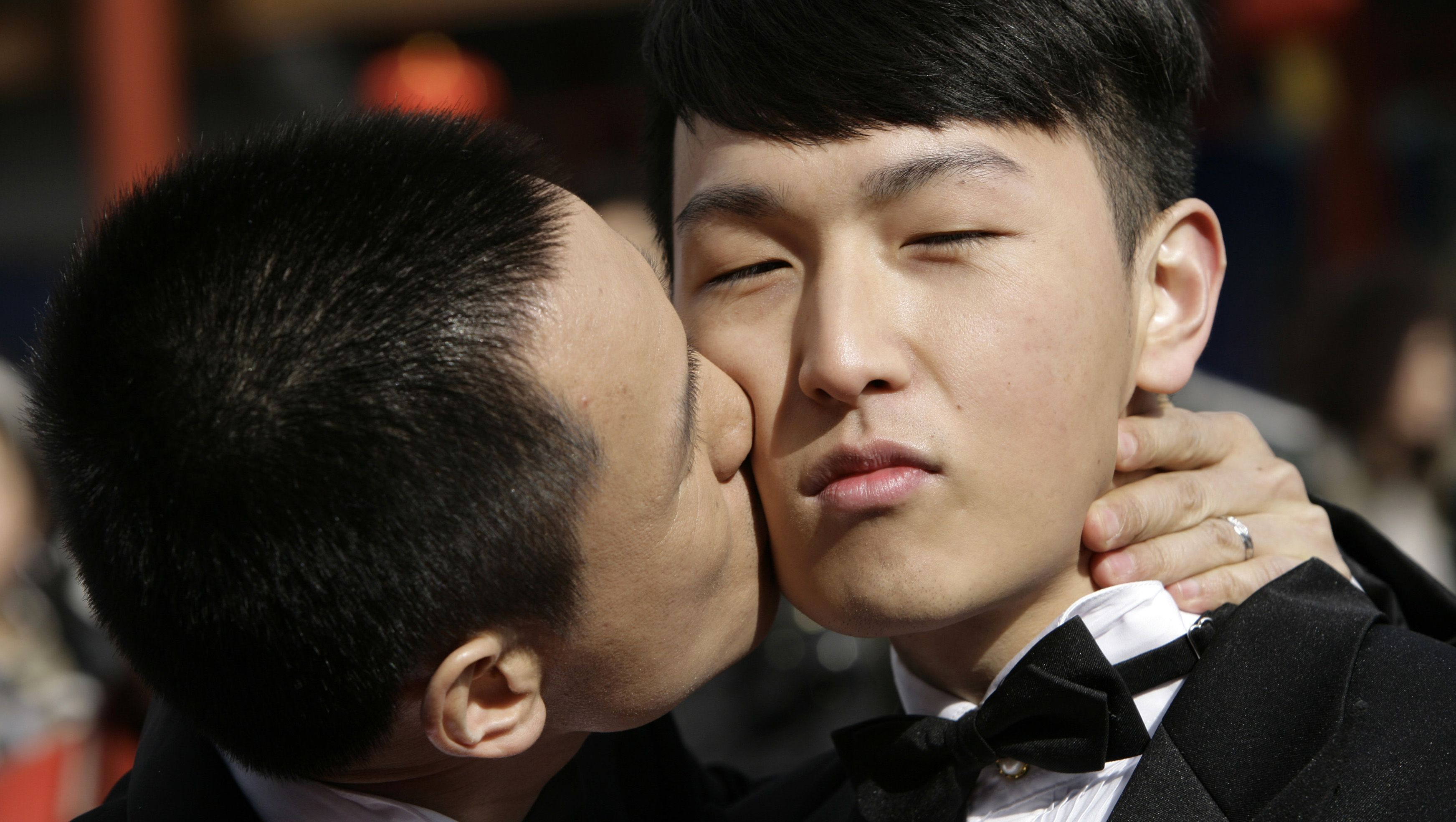 Zhang Yi (L) kisses Hai Bei as the same-sex couple pose for their wedding photographs at Qianmen street on Valentine's Day in Beijing February 14, 2009. For some in Beijing's gay and lesbian community, Valentine's Day is not just a day to celebrate loving relationships but also an ideal time to campaign for same-sex marriages and the acceptance of homosexuality in China. REUTERS/Jason Lee