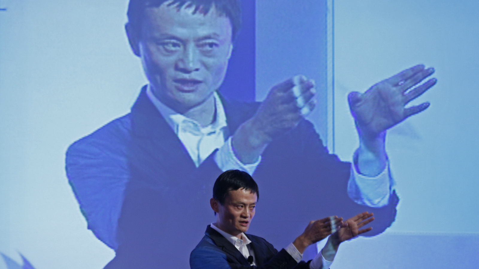 Jack Ma, chairman of China's largest e-commerce firm Alibaba Group, gestures during a conference in Hong Kong Wednesday, March 20, 2012. Ma expects 30 percent of China's total retail sales to be conducted online in five years' time. (AP Photo/Vincent Yu)