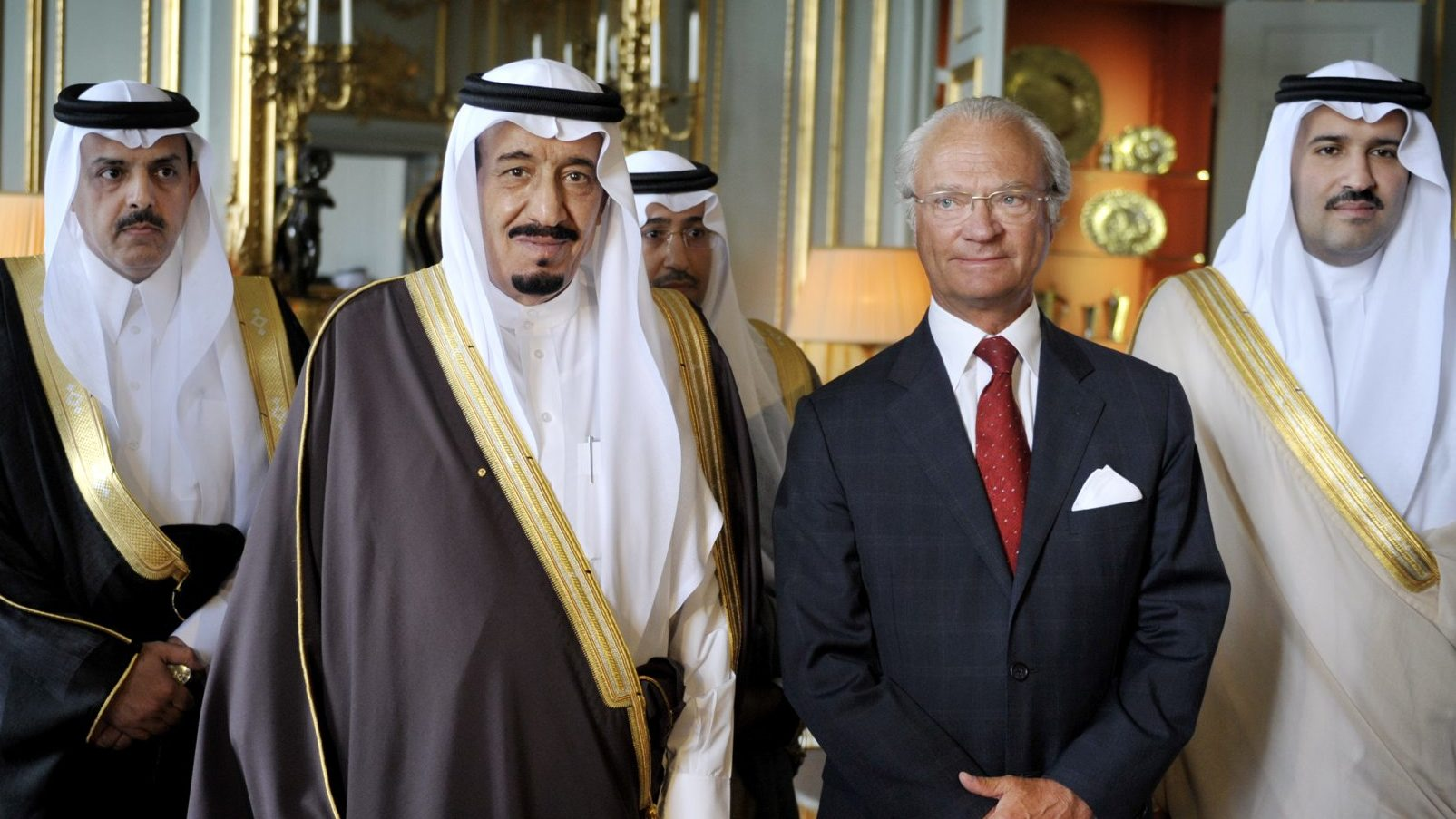 Prince Salman bin Abdul Aziz Al Saud, 2nd left, of Saudi Arabia, and King Carl Gustaf, 3rd left, of Sweden pose for photographers at an audience at the Royal Palace, Stockholm, Saturday, June 28, 2008. Prince Salman, Governor of Riyadh is in Sweden for a three-day official visit to Stockholm invited by the Governor of Stockholm. Men in background are unidentified.
