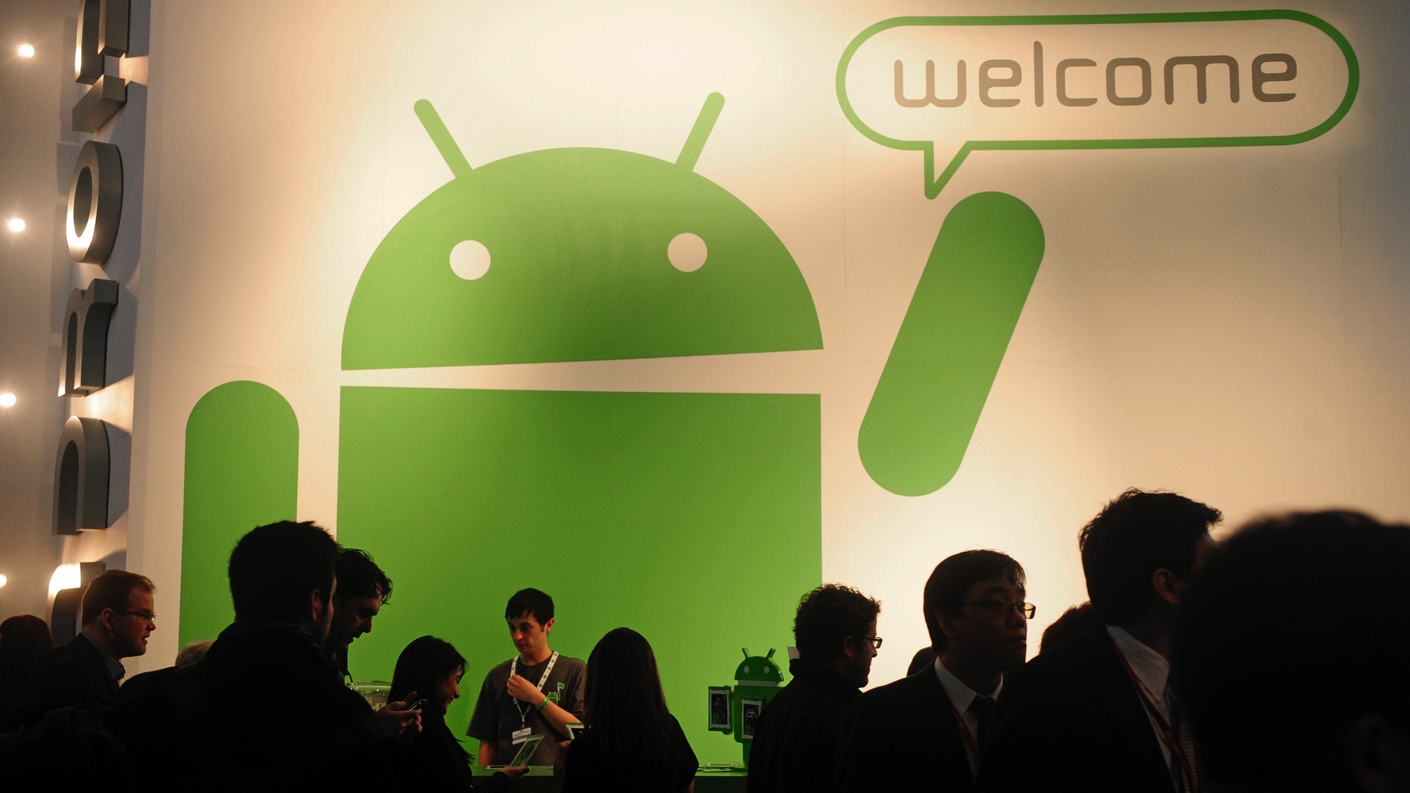 Participants gather around the Google Android stand at the Mobile World Congress in Barcelona, Spain, Thursday, Feb. 17, 2011. The Mobile World Congress will be held from Feb. 14-17. (AP Photo/Manu Fernandez)