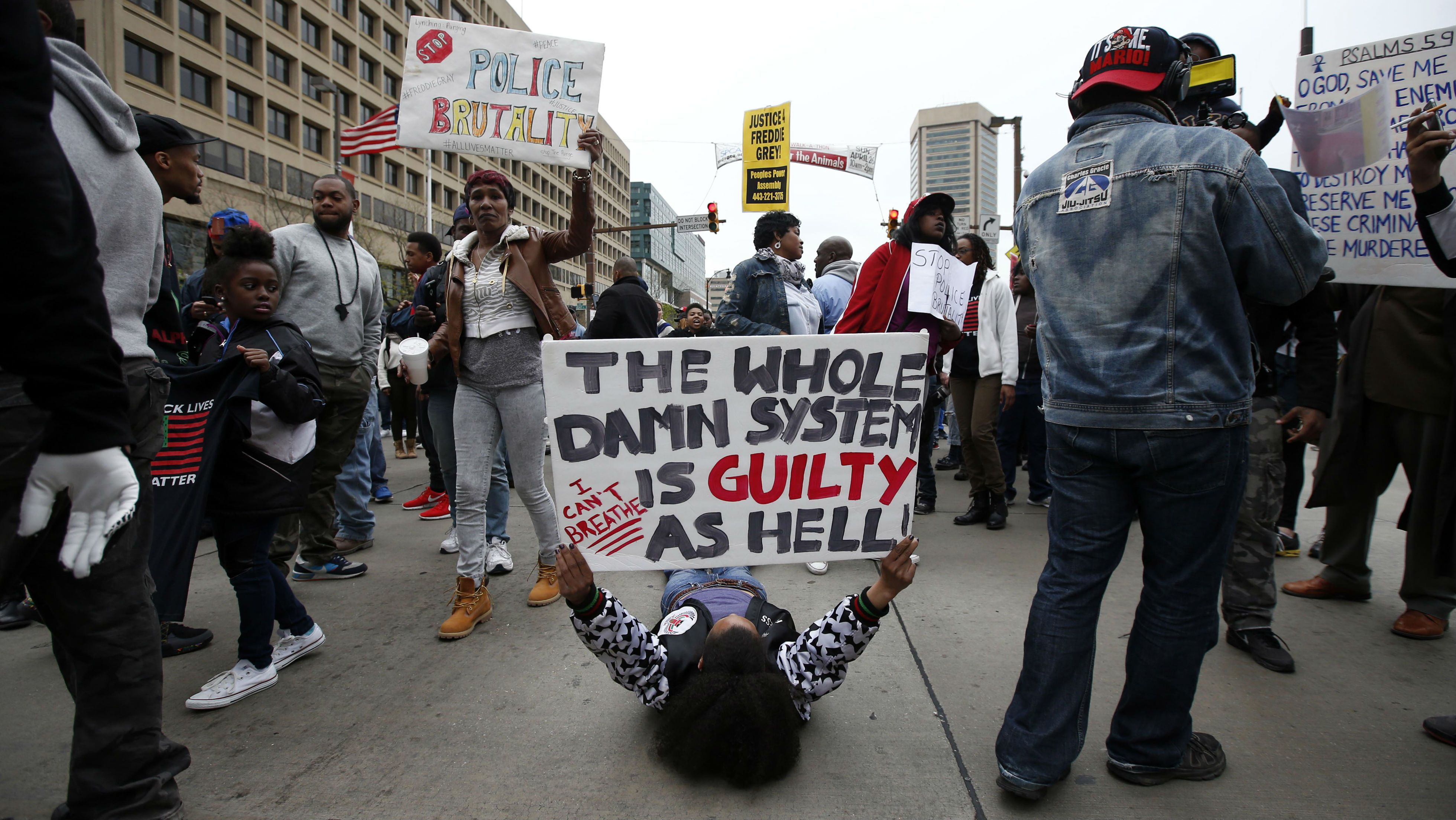 Marchers block the Pratt Street after a march to City Hall for Freddie Gray, Saturday, April 25, 2015 in Baltimore. Gray died from spinal injuries about a week after he was arrested and transported in a police van. (AP Photo/Alex Brandon)