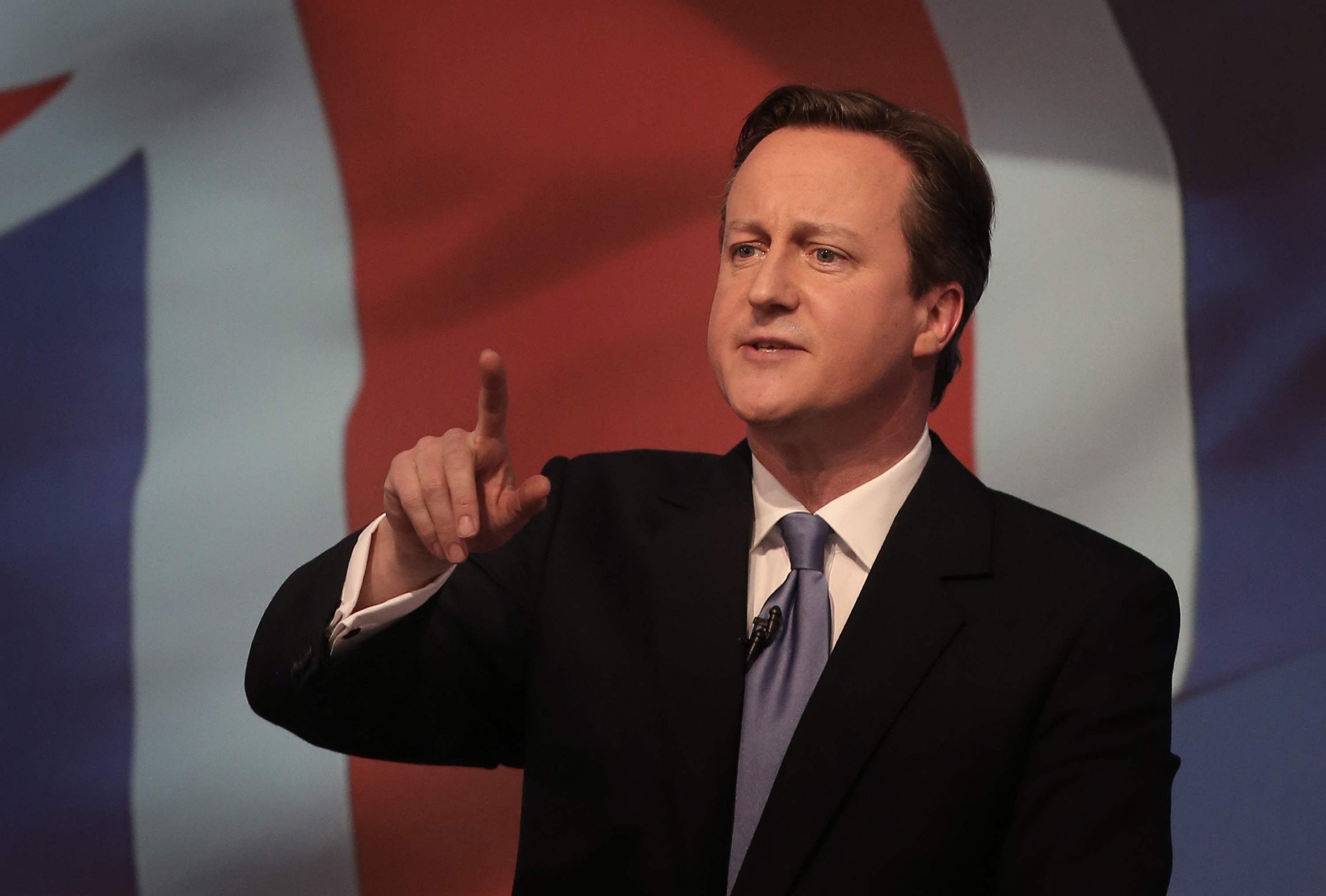 Britain's  Prime Minister David Cameron gestures as he unveils the Conservative party manifesto, in Swindon, England, Tuesday April 14, 2015.  Britain goes to the polls for a parliamentary election on Thursday May 7, 2015. (Peter Macdiarmid, Pool Photo via AP)