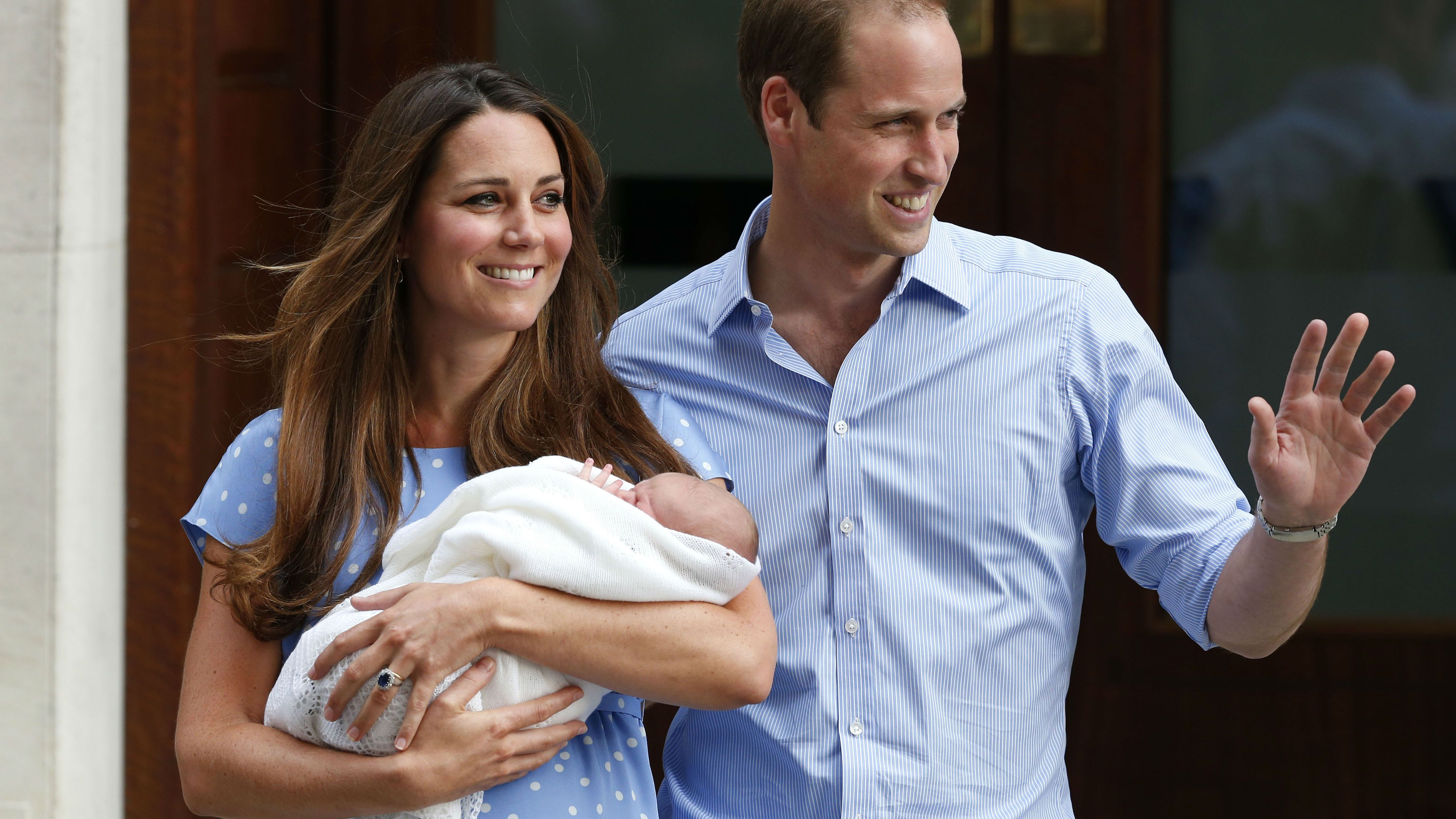 FOR USE AS DESIRED, YEAR END PHOTOS - FILE - Britain's Prince William and Kate, Duchess of Cambridge hold the Prince of Cambridge, Tuesday July 23, 2013, as they pose for photographers outside St. Mary's Hospital exclusive Lindo Wing in London where the Duchess gave birth. (AP Photo/Lefteris Pitarakis, File)