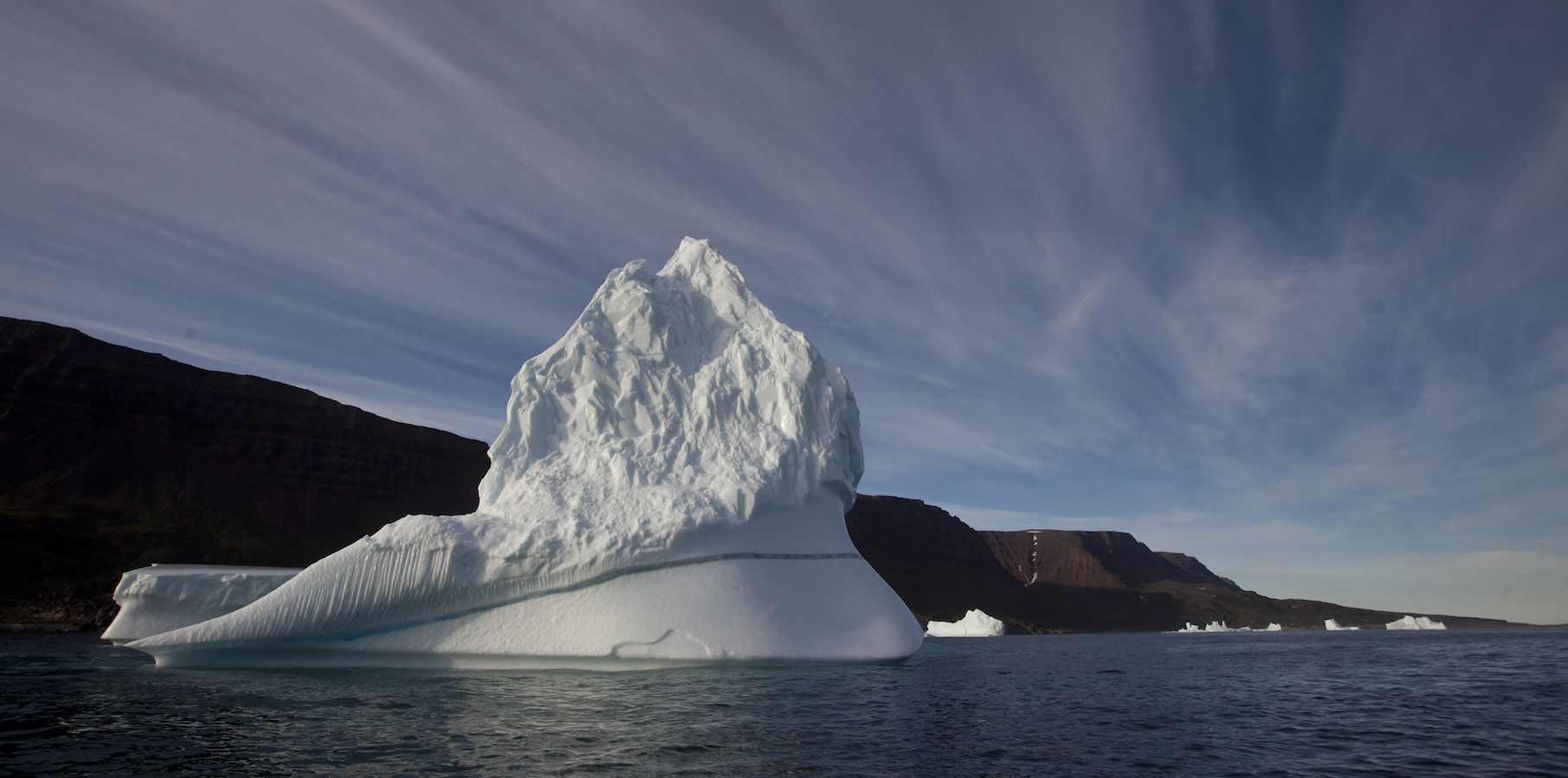 FILE - In this July 21, 2011 file  photo, an iceberg floats in the sea near Qeqertarsuaq, Disko Island, Greenland.  Norway is looking into providing high-speed Internet in one of the few places on Earth where it's not available: the Arctic. Demand for high-speed Internet in the Arctic is expected to grow as shipping, fishing and oil companies move north amid warming temperatures and melting ice.(AP Photo/Brennan Linsley, File)