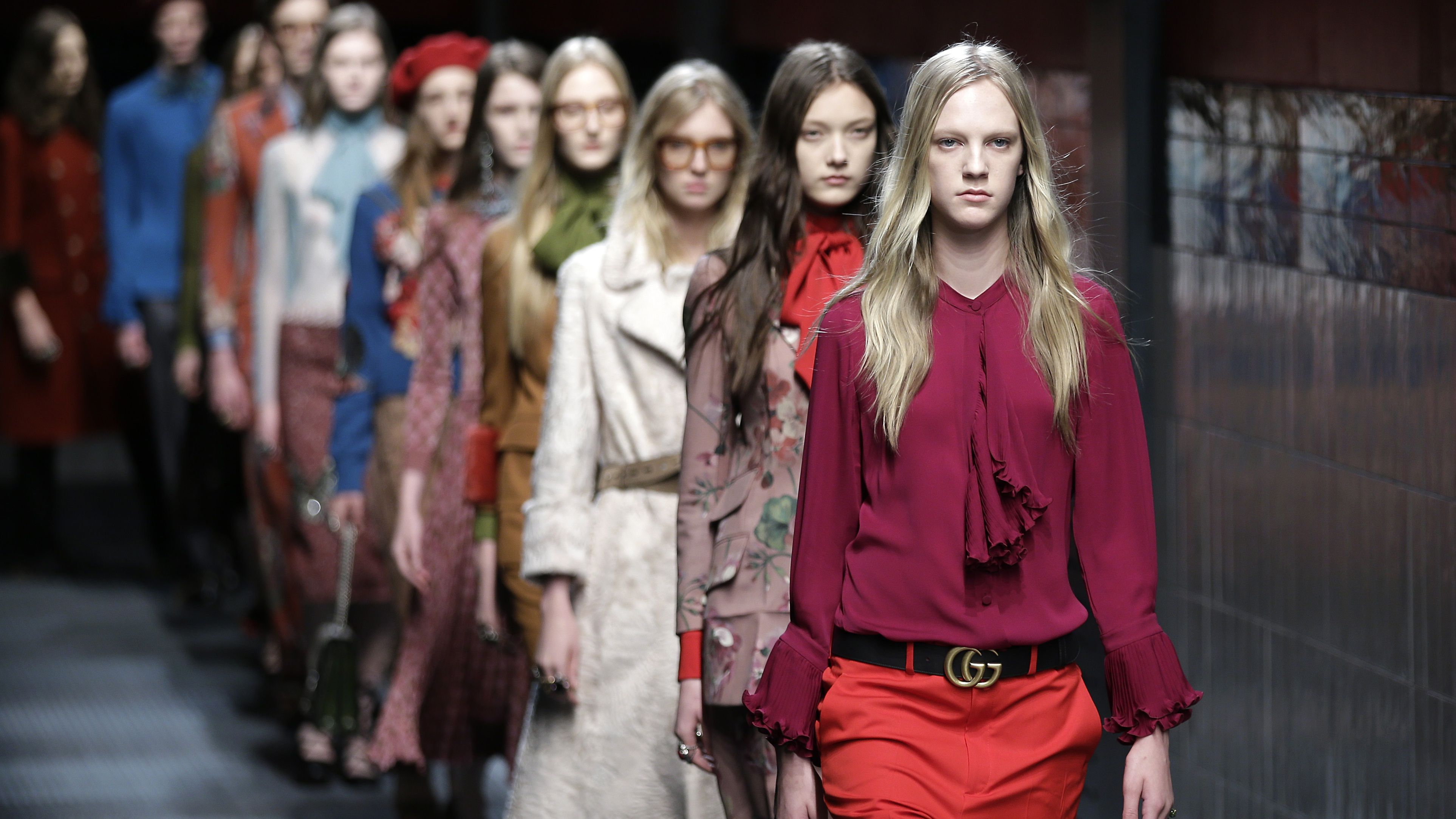 Models wear creations for Gucci women's Fall-Winter 2015-2016 collection, part of the Milan Fashion Week, unveiled in Milan, Italy, Wednesday, Feb. 25, 2015.