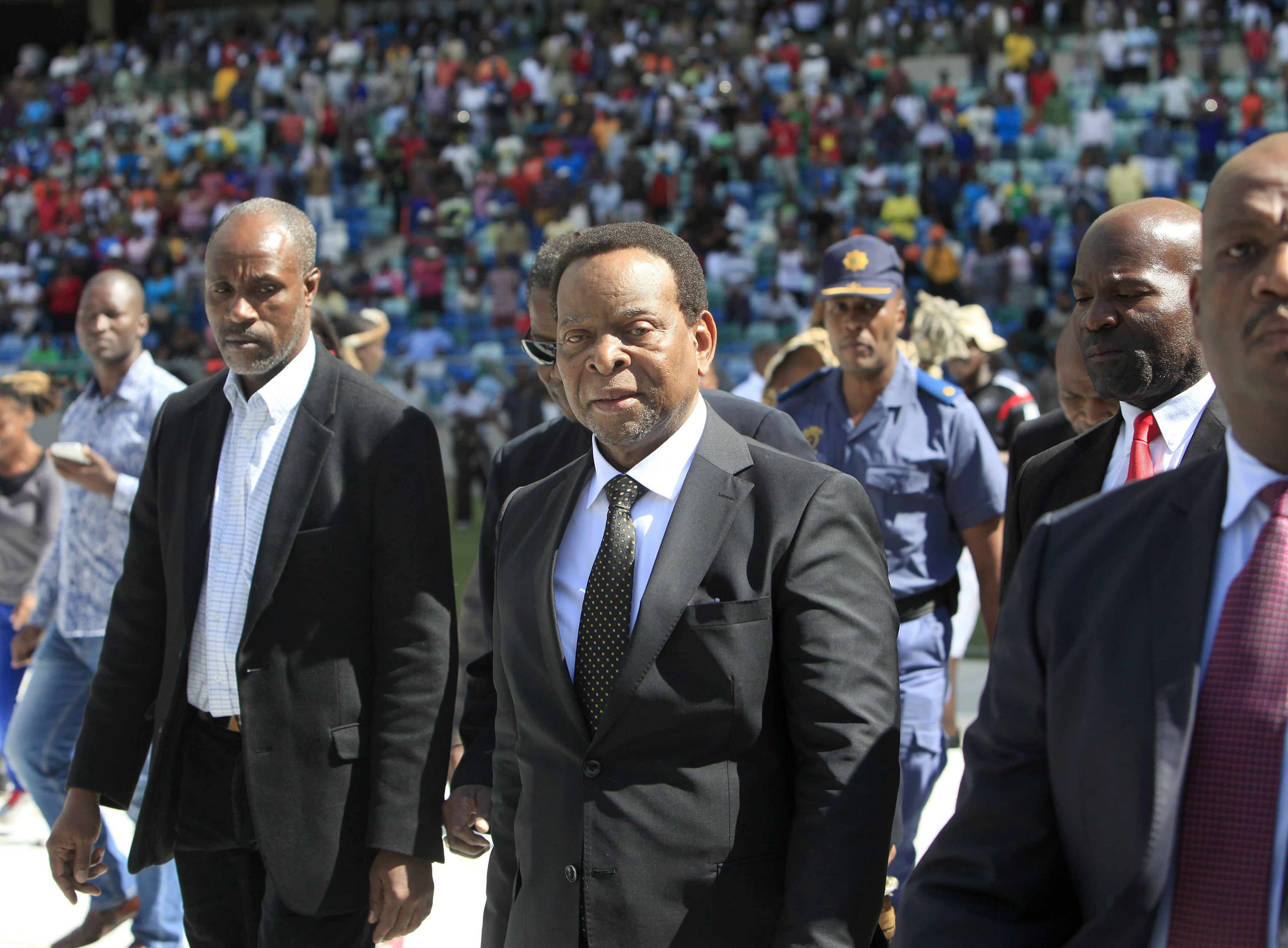 Zulu King Goodwill Zwelithini, center, arrives at a Zulu gathering, at the Moses Mabhida Stadium, in Durban, South Africa, Monday, April 20, 2015. He has condemned recent deadly attacks on immigrants following reported comments in which he said foreigners should leave the country. Zwelithini, an influential figure among the Zulu ethnic group, said the violence was unacceptable in a speech Monday at a sports stadium in Durban, a coastal city where six people have died in anti-immigrant violence. (AP Photo)