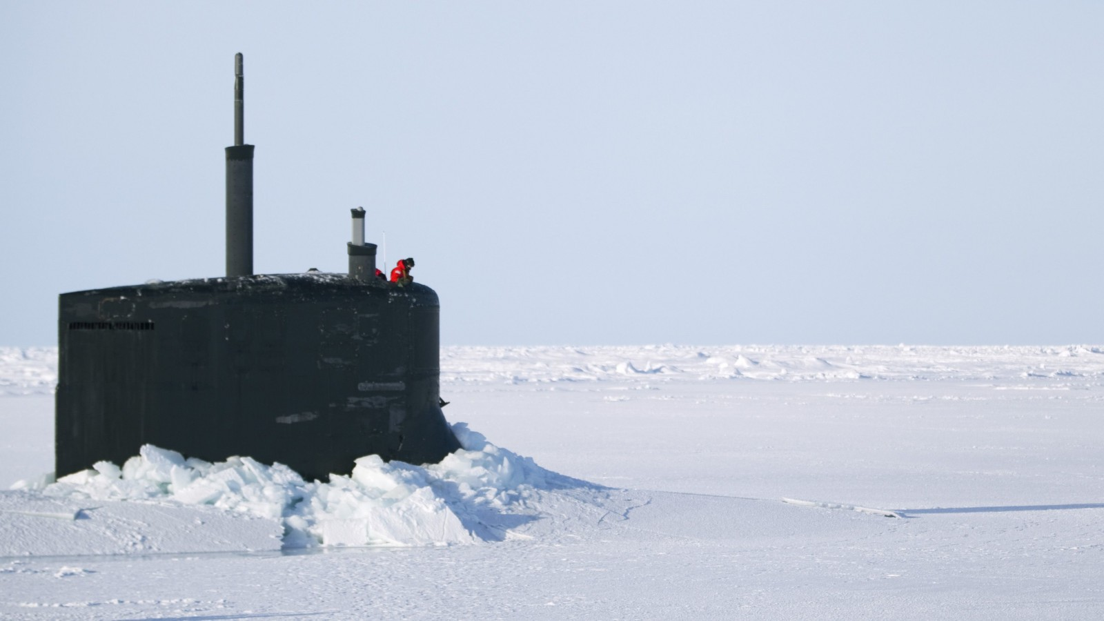 A US Navy sailor looks off the bridge of the Seawolf class submarine USS Connecticut after surfacing through Arctic sea ice north of Prudhoe Bay