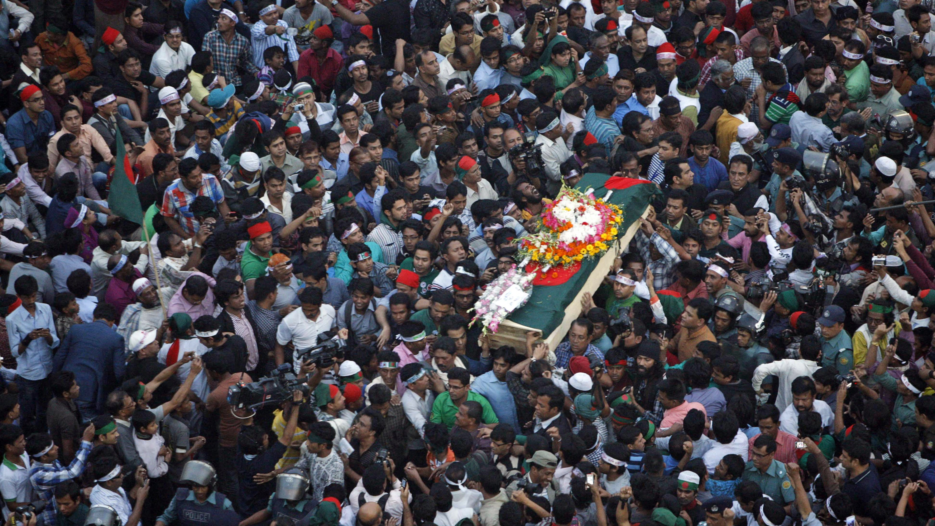 Bangladeshi mourners carry the coffin containing the body of blogger Ahmed Rajib Haider for funeral in Dhaka, Bangladesh. (Feb. 2013)