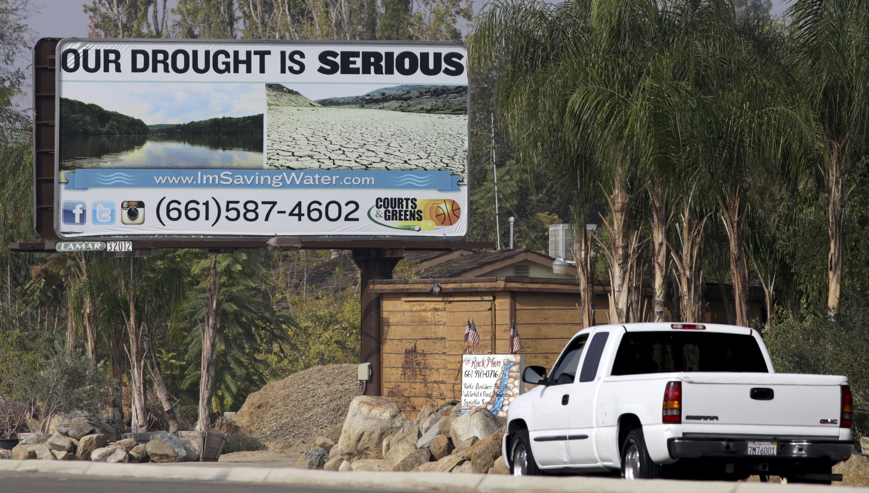 """A sign reading """"Our Drought Is Serious"""" is pictured on the side of a road in Bakersfield, California November 9, 2014. REUTERS/Jonathan Alcorn"""