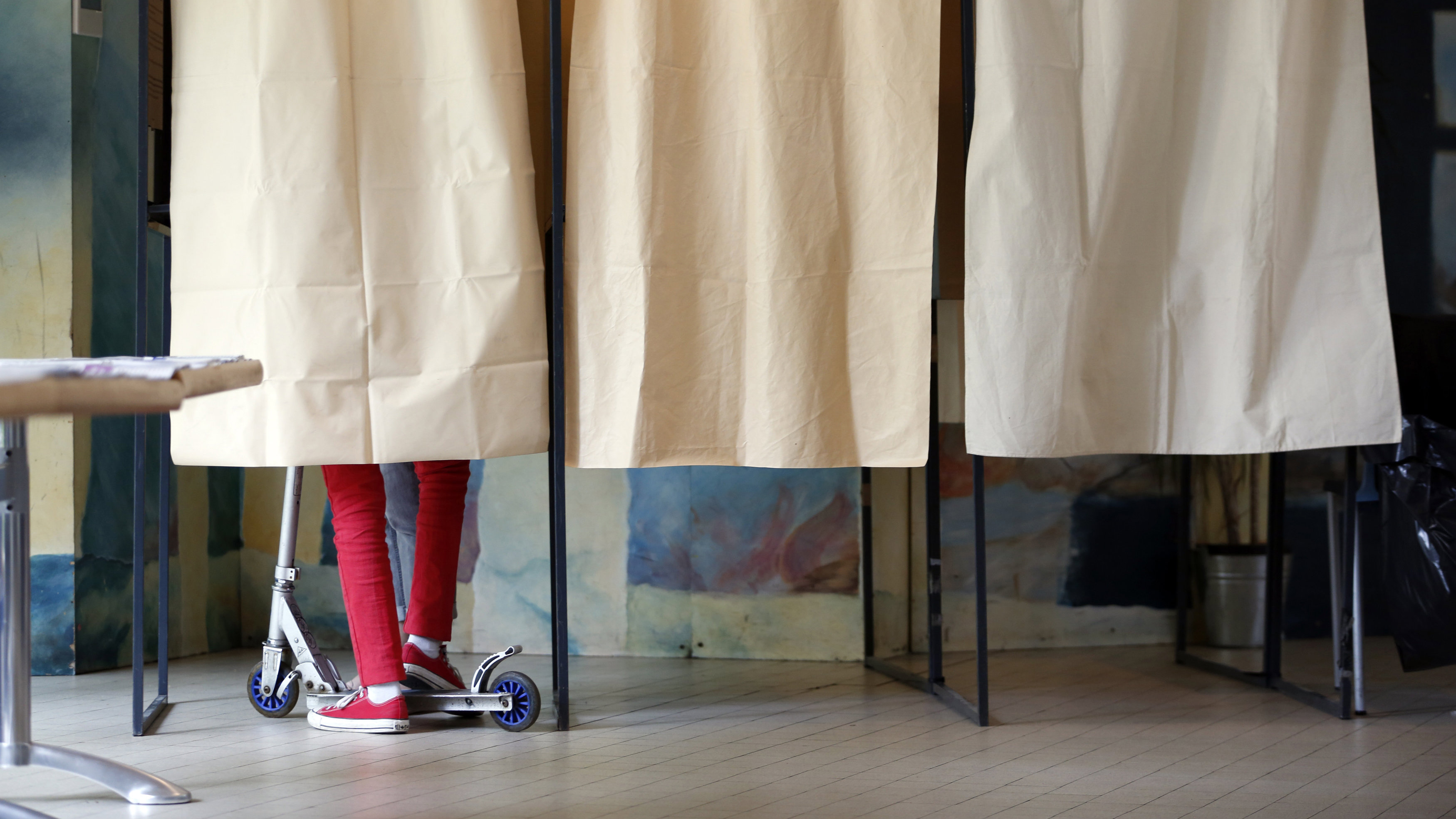 child in voting booth