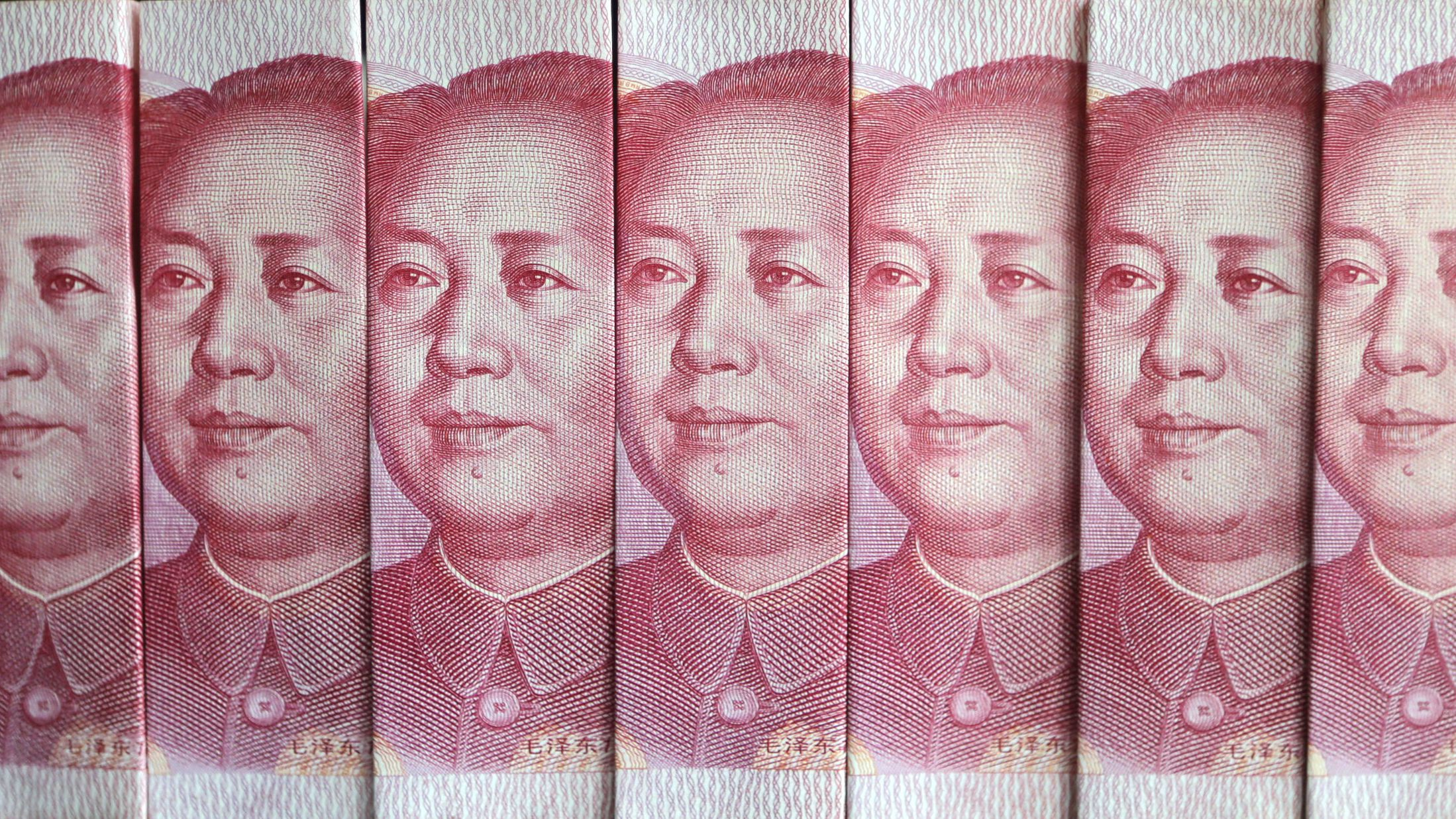 Chinese 100 yuan banknotes are seen in this picture illustration taken in Beijing July 11, 2013. China's central bank has standardised rules on cross-border yuan transactions for domestic banks and companies, the latest step to boost the yuan's global influence. REUTERS/Jason Lee (CHINA - Tags: BUSINESS TPX IMAGES OF THE DAY)