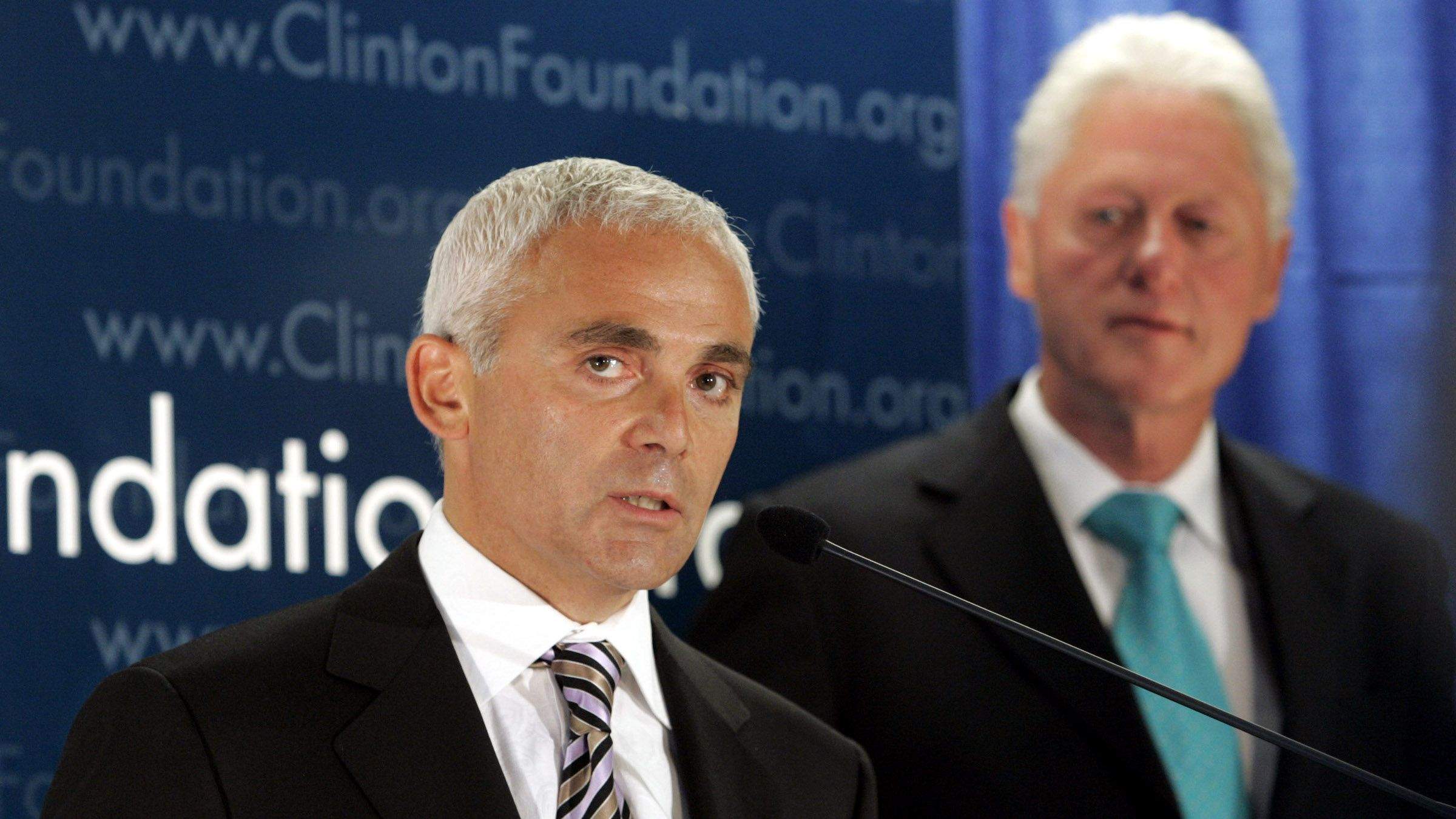 ** FILE ** In this June 21, 2007 file photo, Frank Giustra, a Canadian businessman, speaks as former President Bill Clinton looks on during a news conference in New York to announce the Clinton Foundation's launching of a new sustainable development initiative in Latin America. A donor list released on New Year's Day by the William J. Clinton Foundation shows that Giustra gave to the former president's charity.