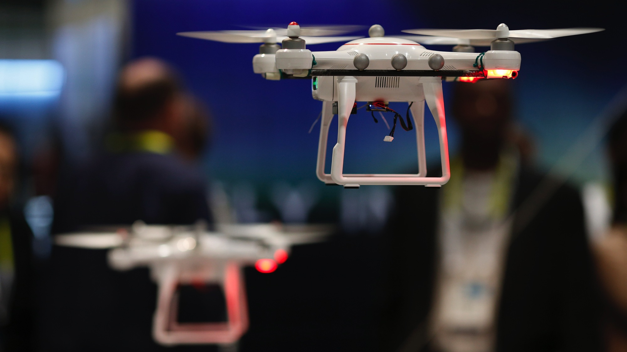 Drones fly at the Autel booth during the International CES Wednesday, Jan. 7, 2015, in Las Vegas.