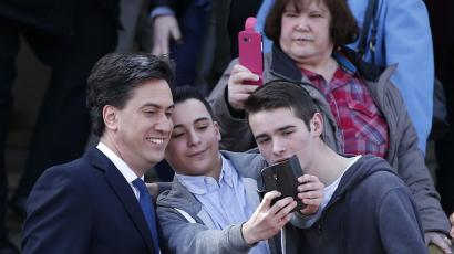 Britain's opposition Labour Party leader Ed Miliband poses for a selfie .