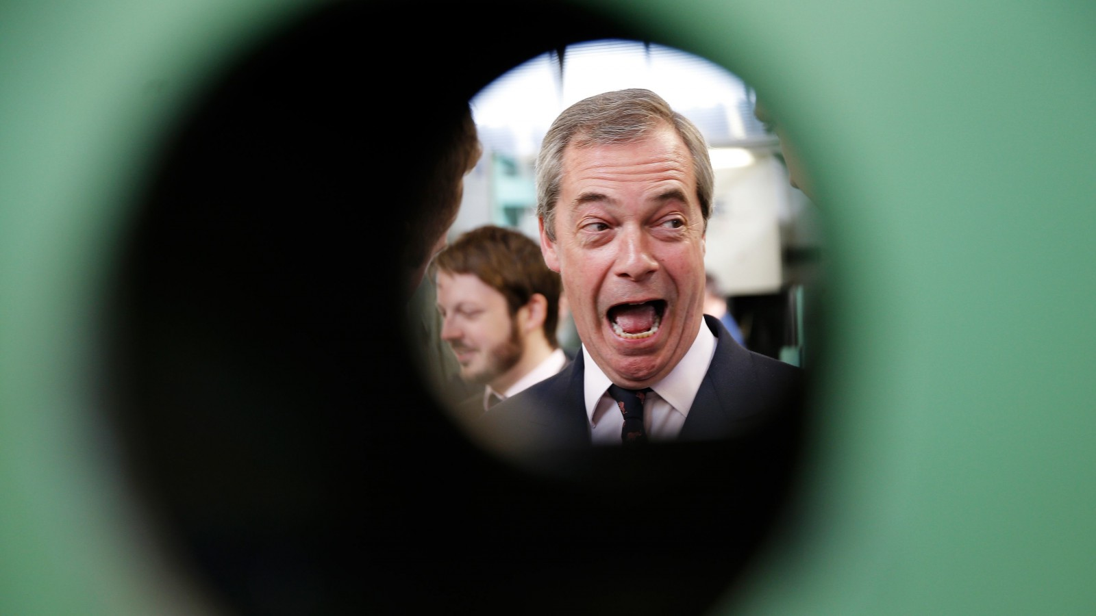 Nigel Farage, the leader of the United Kingdom Independence Party, laughs during a visit to a factory in Clacton, Essex, April 13, 2015.  REUTERS/Peter Nicholls TPX IMAGES OF THE DAY  - RTR4X422