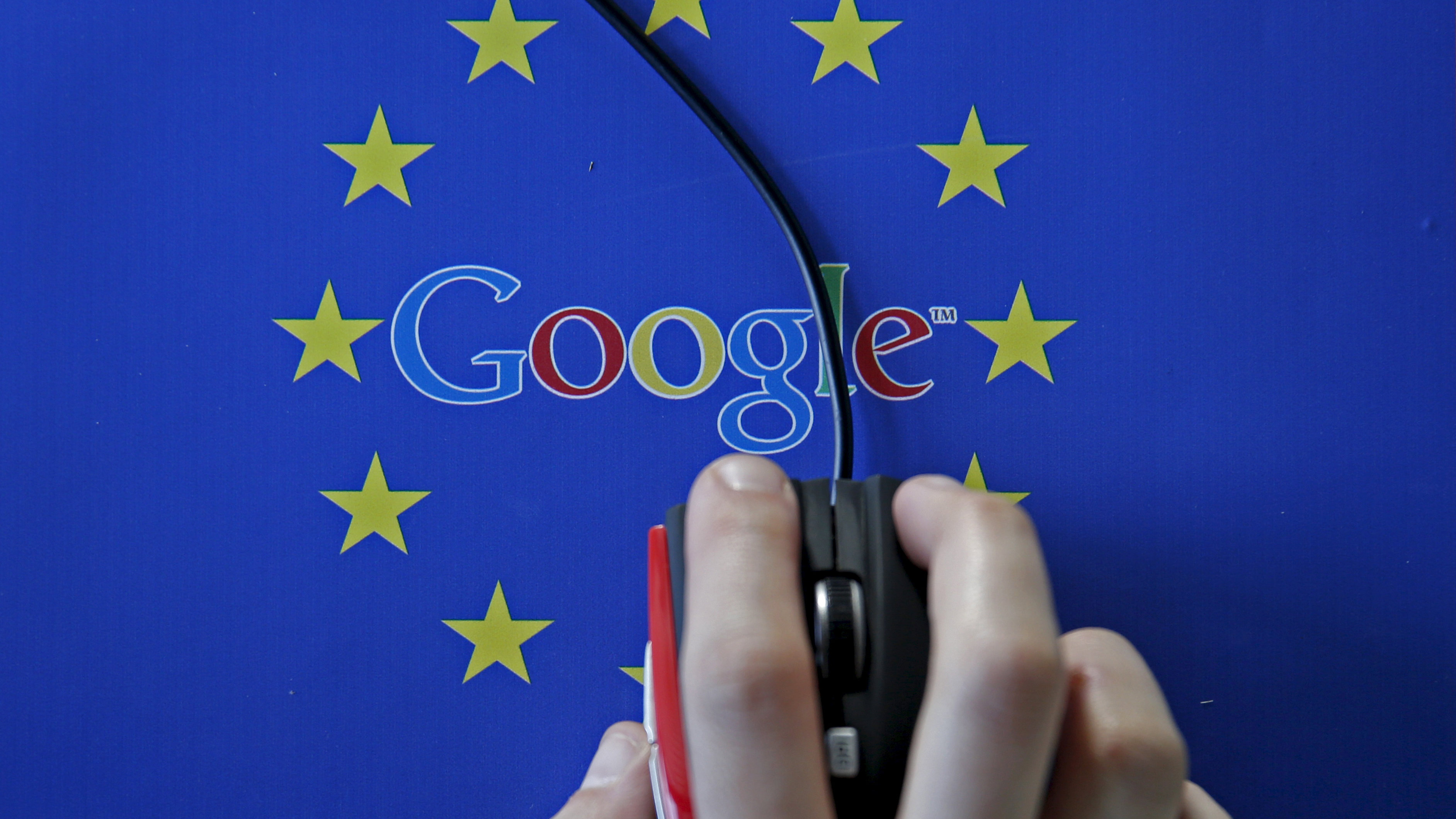 A woman hovers a mouse over the Google and European Union logos in Sarajevo, in this April 15, 2015 photo illustration. The European Union accused Google Inc on Wednesday of cheating competitors by distorting Internet search results in favour of its Google Shopping service and also launched an antitrust probe into its Android mobile operating system.