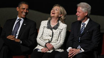 U.S. President Barack Obama (L) shares a laugh with Secretary of State Hillary Clinton (C) and former President Bill Clinton at a funeral service for U.S. Ambassador Richard Holbrooke at the Kennedy Center in Washington, January 14, 2011.